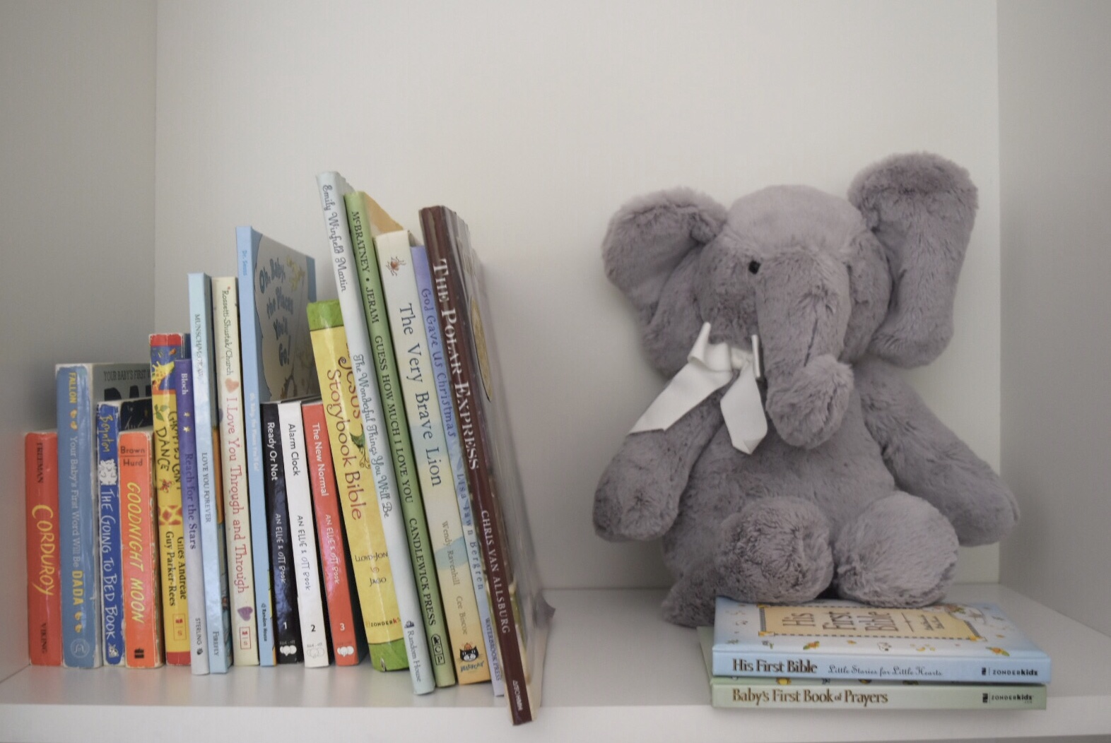 A sneak preview of Max's little newborn library in his remodeled nursery with Emerald Rouge. His little stuffed elephant keeps all Max's favorite books company, including classics like Goodnight Moon, Corduroy, the Polar Express, and more!