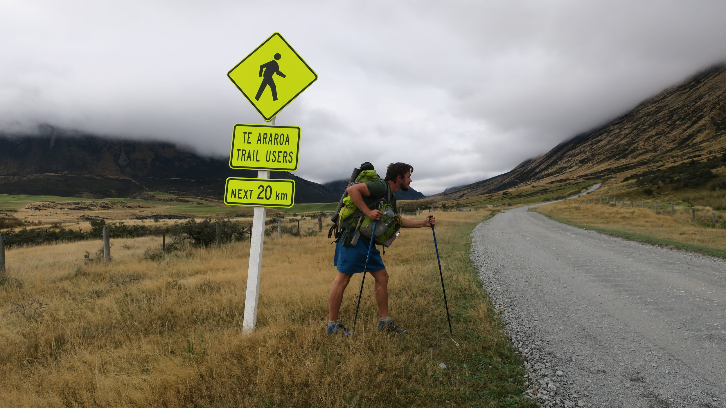 Hiker imitating sign