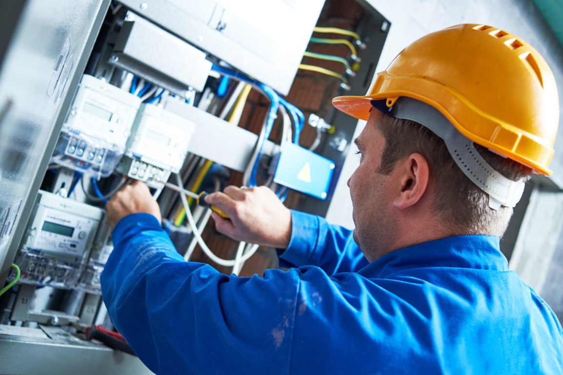 bigstock-Electrician-installing-energy--145004402.jpg