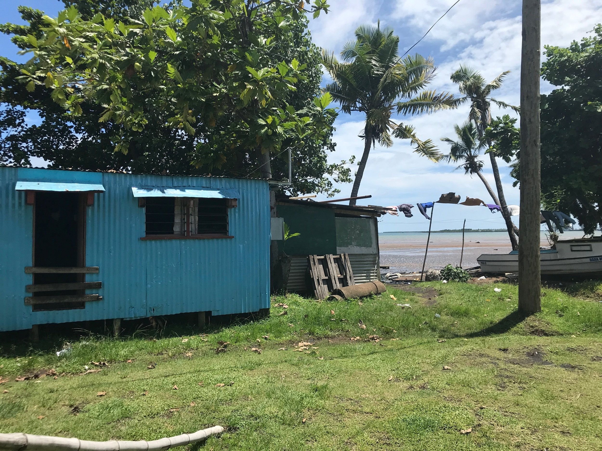 Two homes in the informal settlement community, located on the shore of Fiji's Western coast. Photo By Yanik Rozon
