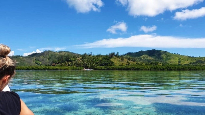 The island of Malolo from our boat's position in the water. Photo by Yanik ROzon.