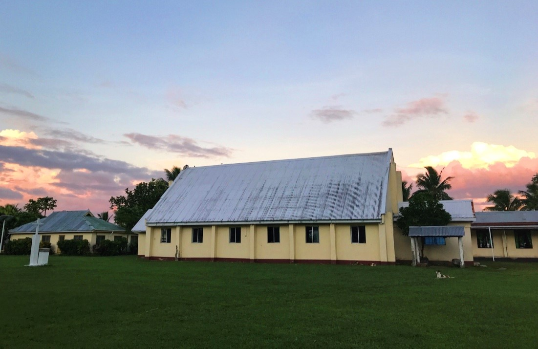 The village's community hall prior to out meeting's commencement, taken at sunset. Photo By Yanik Rozon.