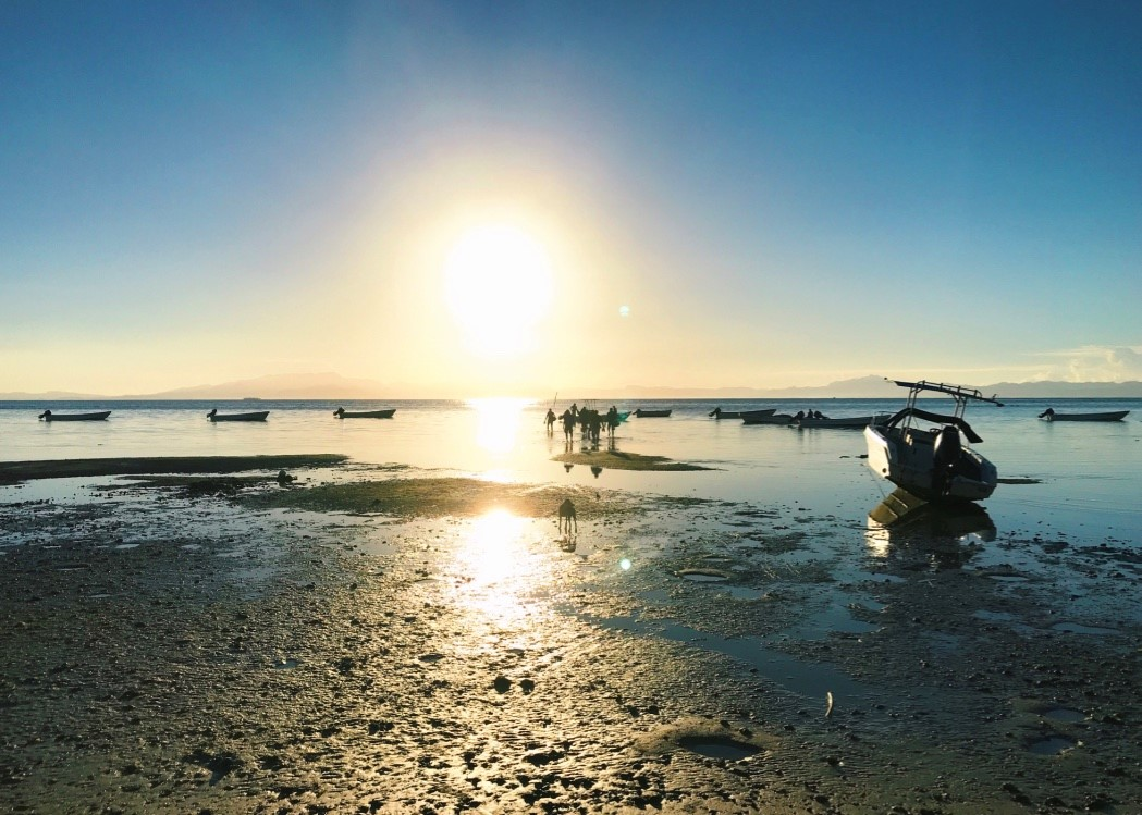 On the shores of Malolo island in the early morning, the village men can be seen making their way to their boats. Some will travel out to sea and continue to practice their traditional fishing livelihoods, while others will travel to resorts to work. Photo by Yanik ROzon.