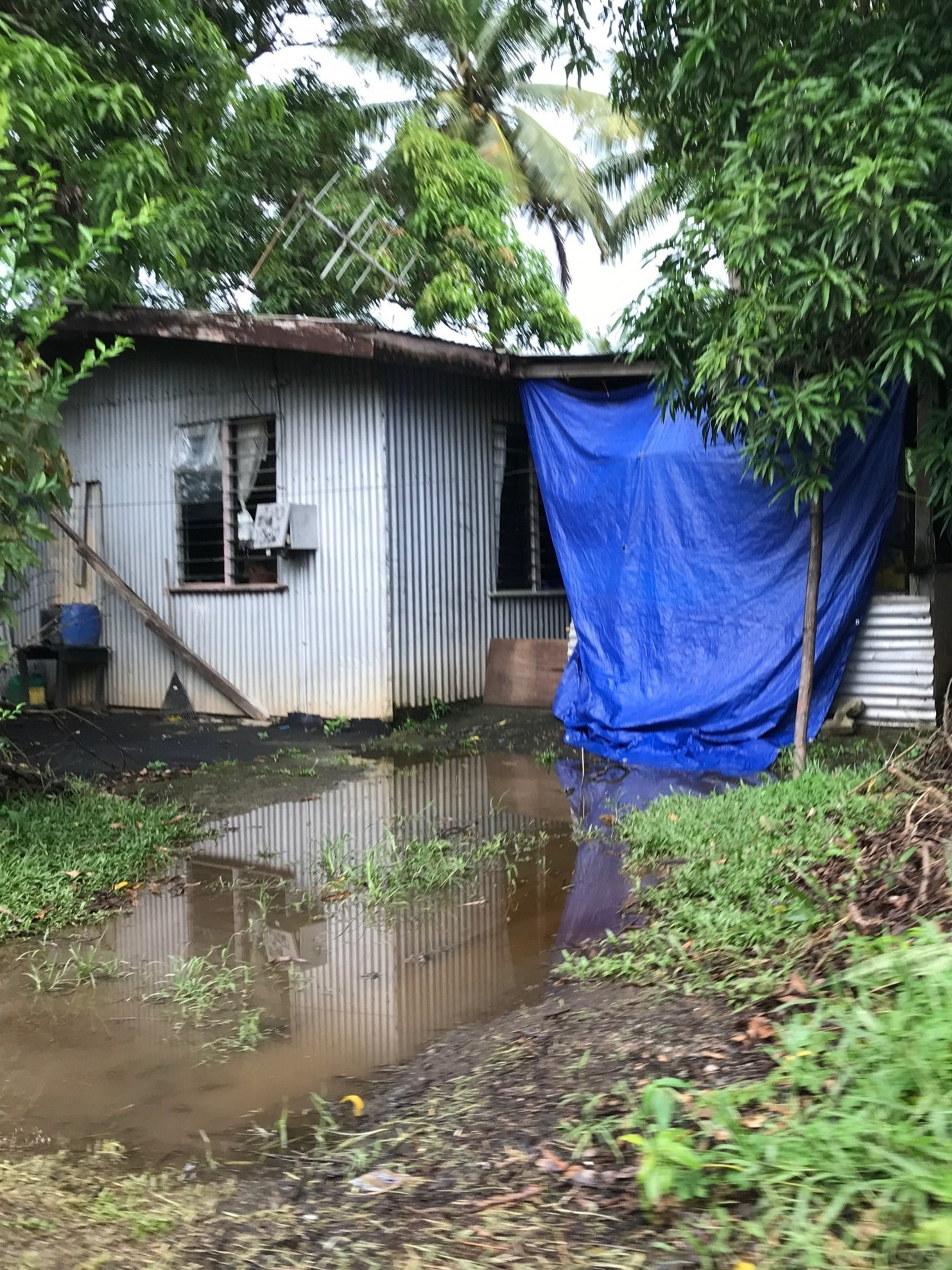 One of the informal settlement homes. This photo was taken approximately five minutes after moderate rainfall. As the settlement is located in a flood-prone region, heavy rains often result in home being entirely submerged beneath water levels. PhoTo by Yanik Rozon.