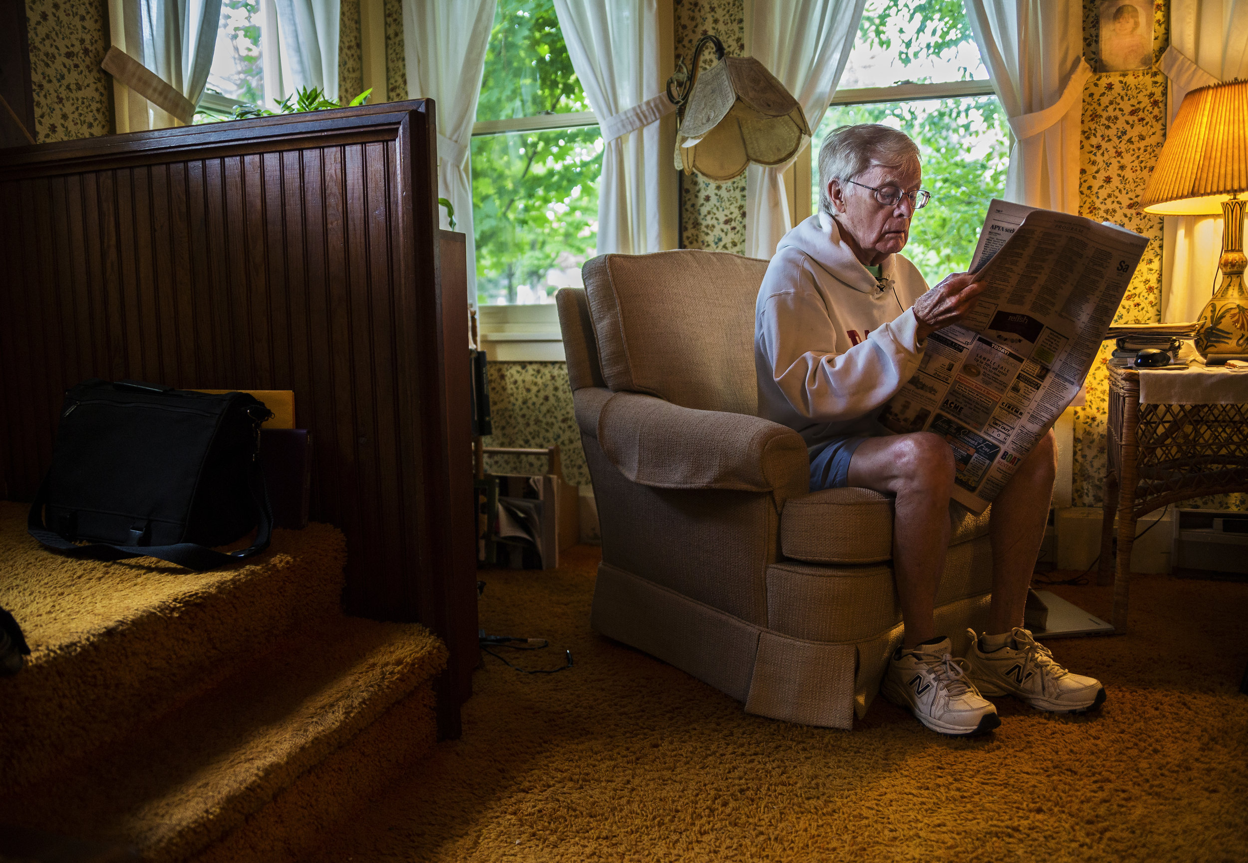 "Bud Horne, 92, looks for his Letter to the Editor in The Chautauquan Daily in his home on Saturday, July 29, 2017. Horne wrote a list of ""Unofficial Rules ""for the Old First Night Race for his fellow runners to read before the big day."