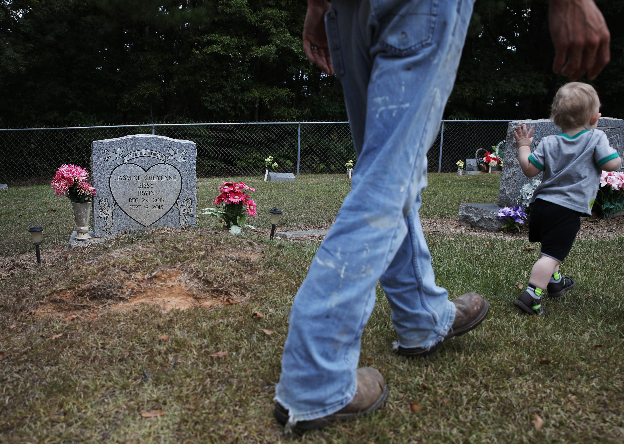 Dylan Mann chases after his 14-month-old stepson Jason while they visit the grave of Dylan's niece, Jasmine. Jasmine was 2-years-old when she was killed by her mother, Tami Mann. Jasmine was killed in September of 2015 and this is the first time that Dylan has visited her grave.