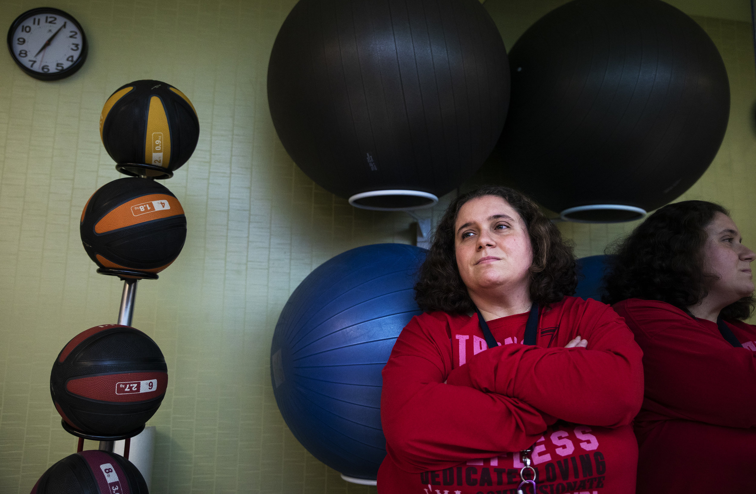 Jessie Fire poses for a portrait in her apartment's gym. Jessie has hydrocephalus and has neurological issues, yet a home fitness training company managed to get her to spend $5000 for six months of training, completely taking advantage of her.