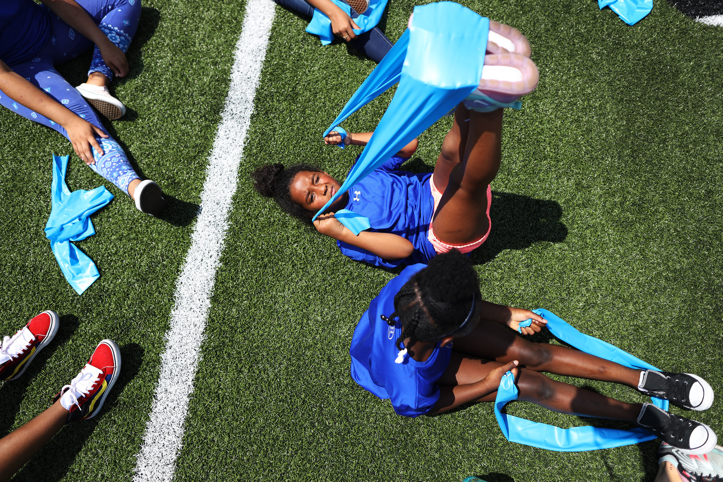 Children learn how to properly stretch during the Boston Police Olympics in Alumni Stadium. The Boys and Girls Clubs of Boston partnered with Boston Police to provide almost 300 children summer programming at Boston College. In its second year, BGCB and the BPD planned a full day of soccer, football, relay races, tug-of-war and of course, ice cream.