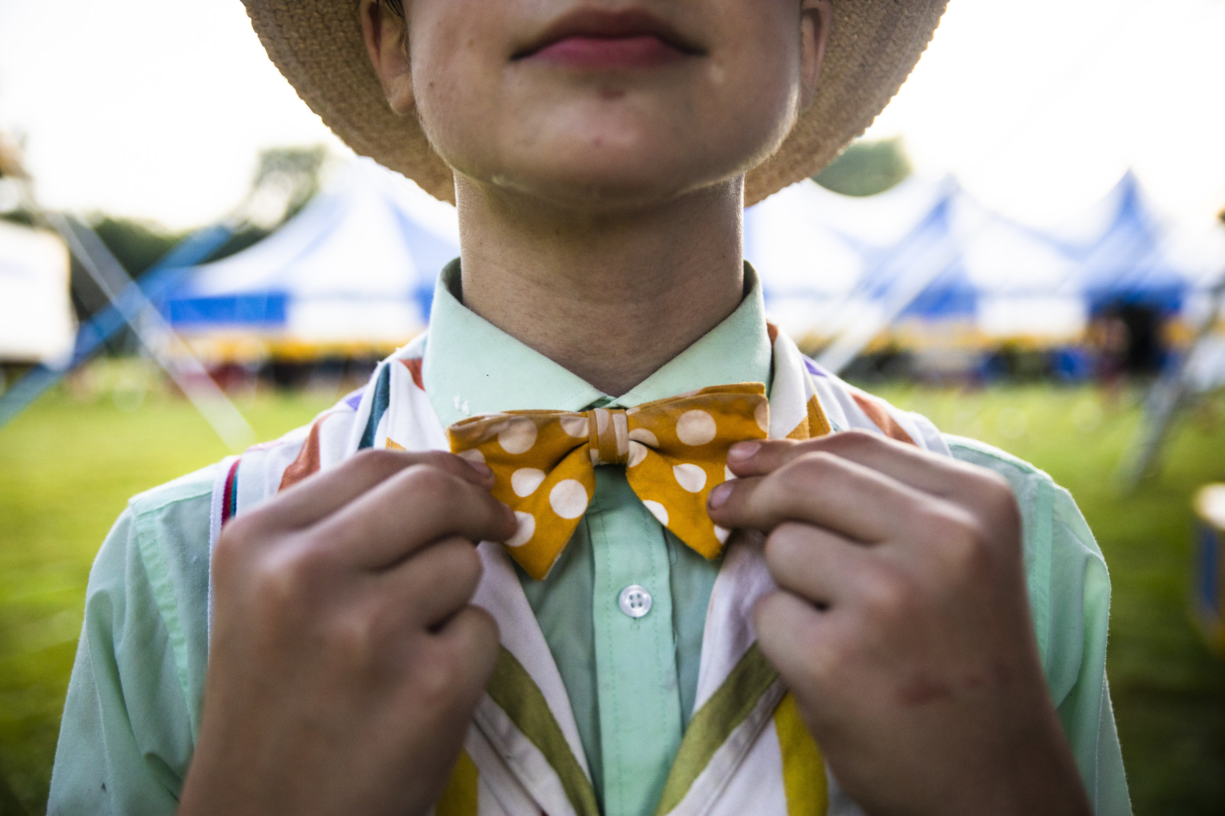 Frederick Buford, 13, adjusts his bowtie before performing in Circus Smirkus' Big Top Tour in the heat of a Hanover, NH afternoon. This is Buford first season with Circus Smirkus. The touring troupe is the only traveling youth circus in the United States and has been existence for over 30 years.