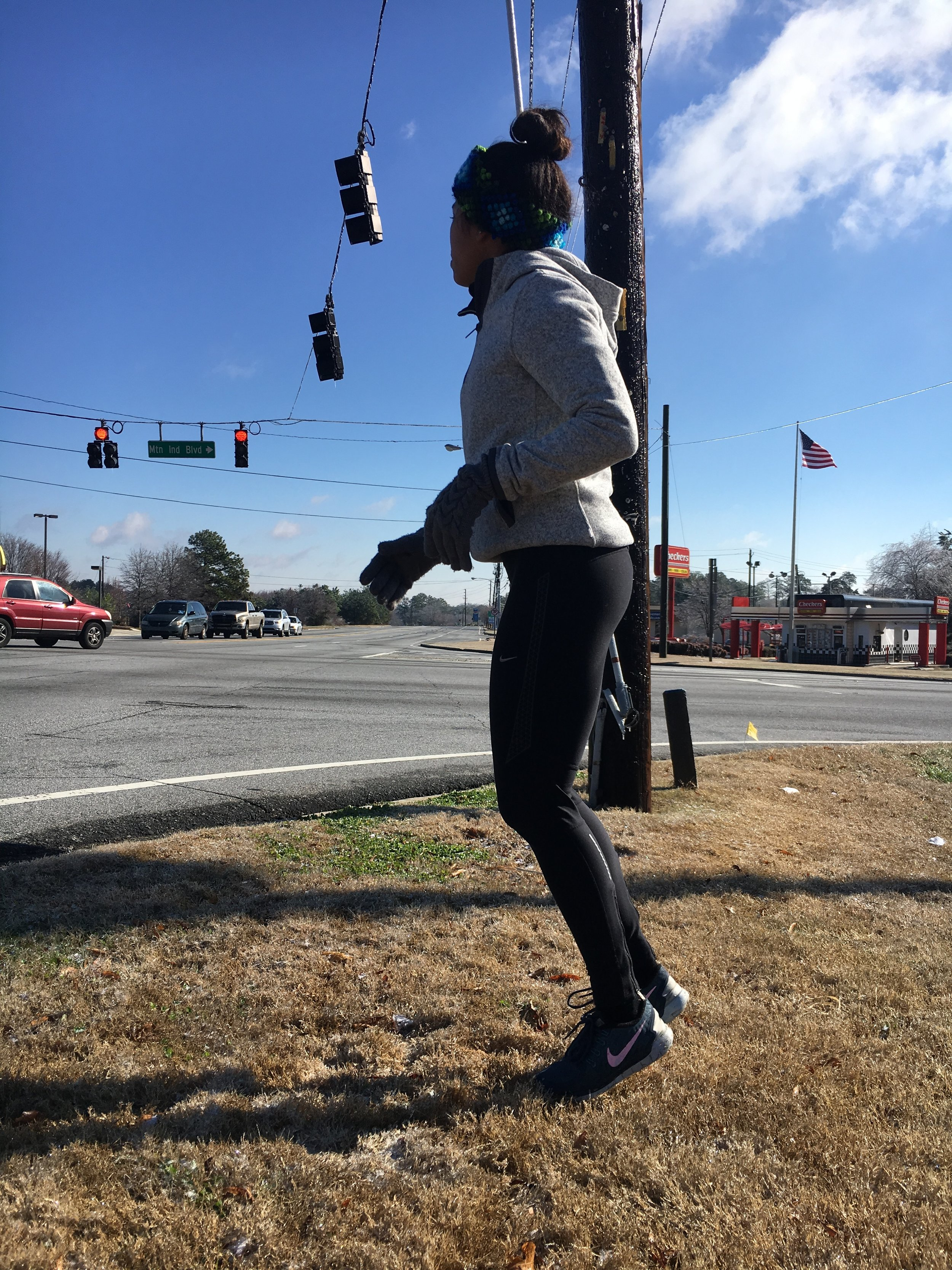 Jogging in place at a traffic light.