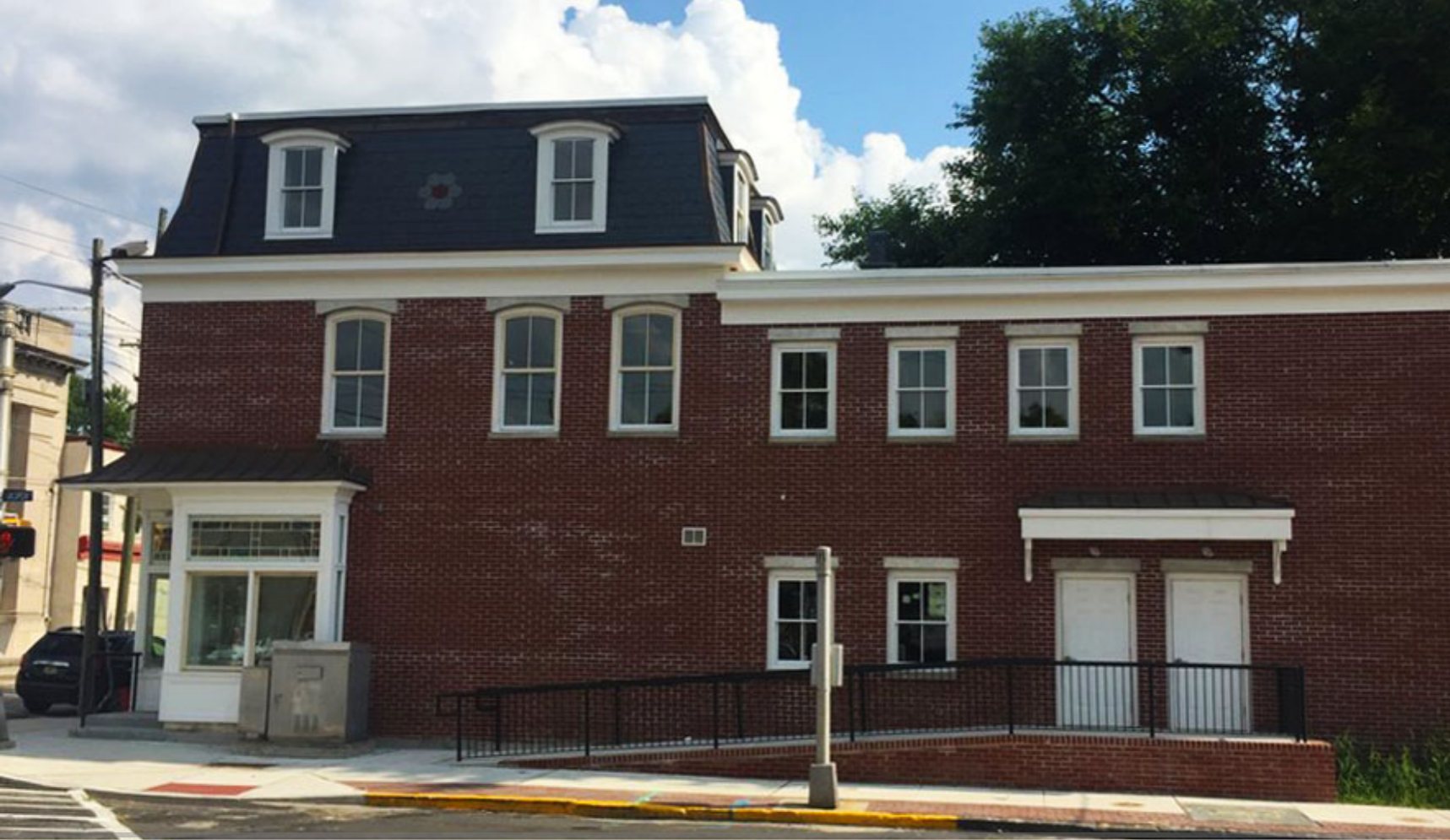A view of the renovated Nick Virgilio Writers House as seen from Jasper Street.