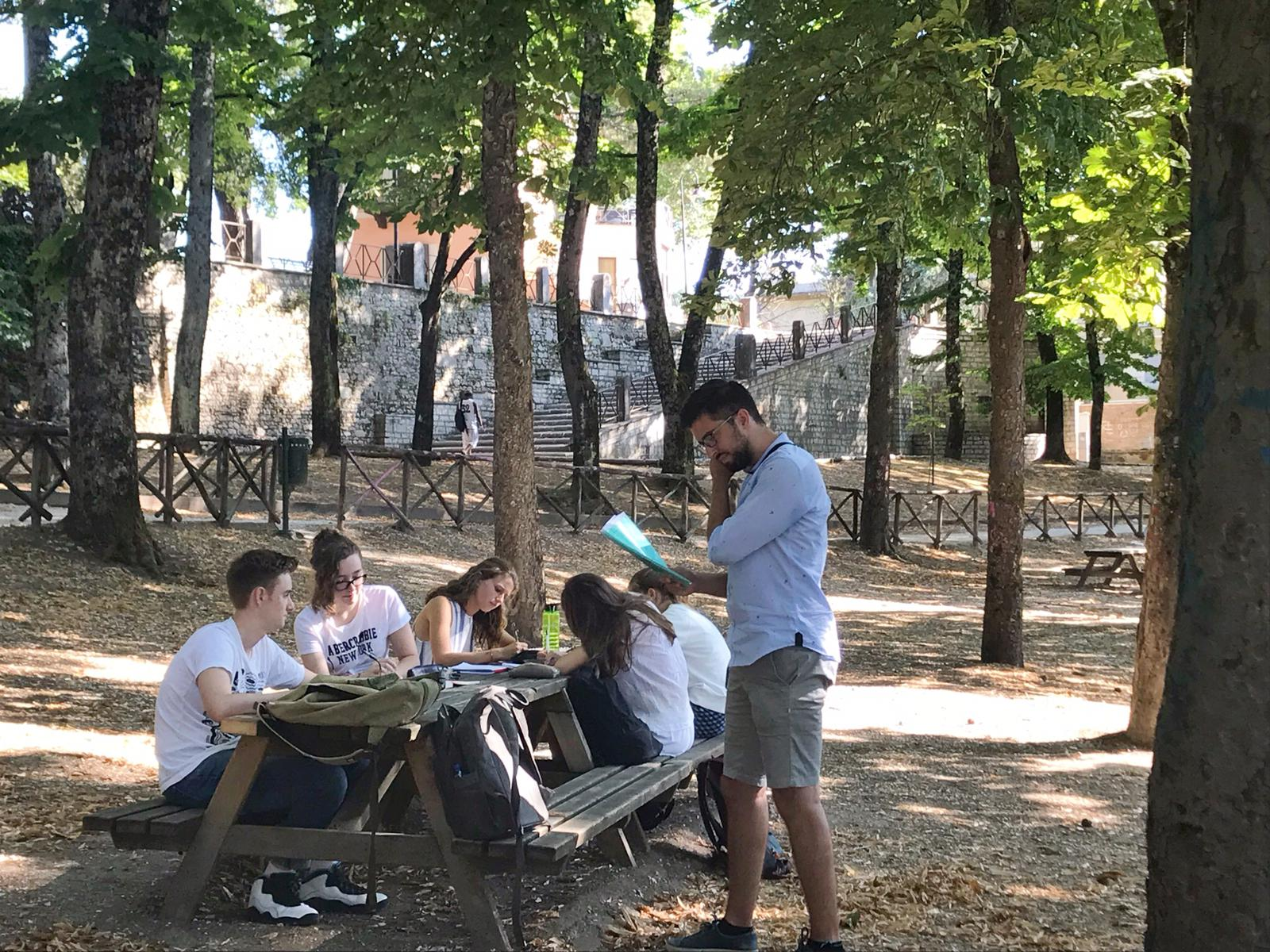 AJ and the creative writing students in the park of Spoleto