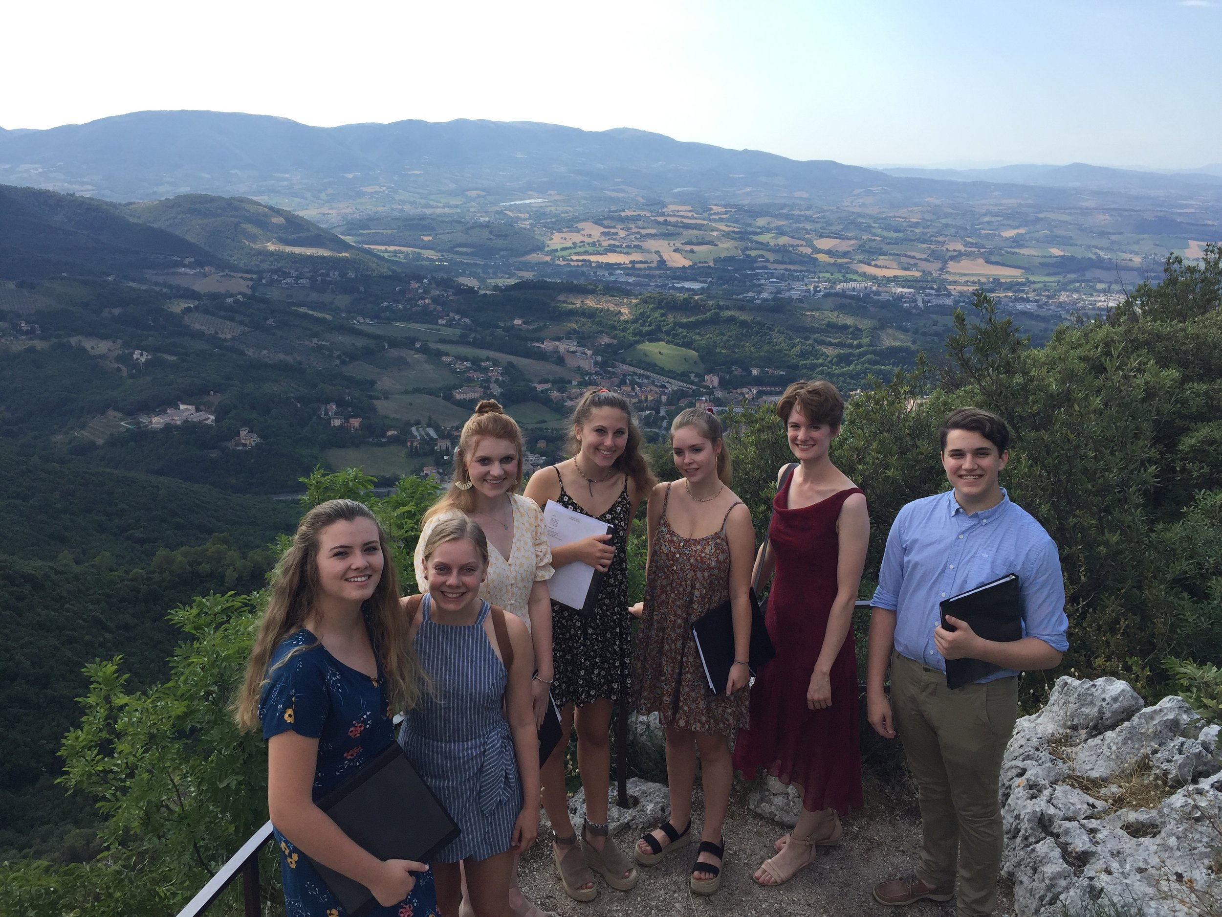 """Our Spoleto Study Abroad music students enjoying the view from Monteluco before an evening concert for a very appreciative crowd, where the choir sang """"Va, pensiero"""" from Verdi's opera  Nabucco."""