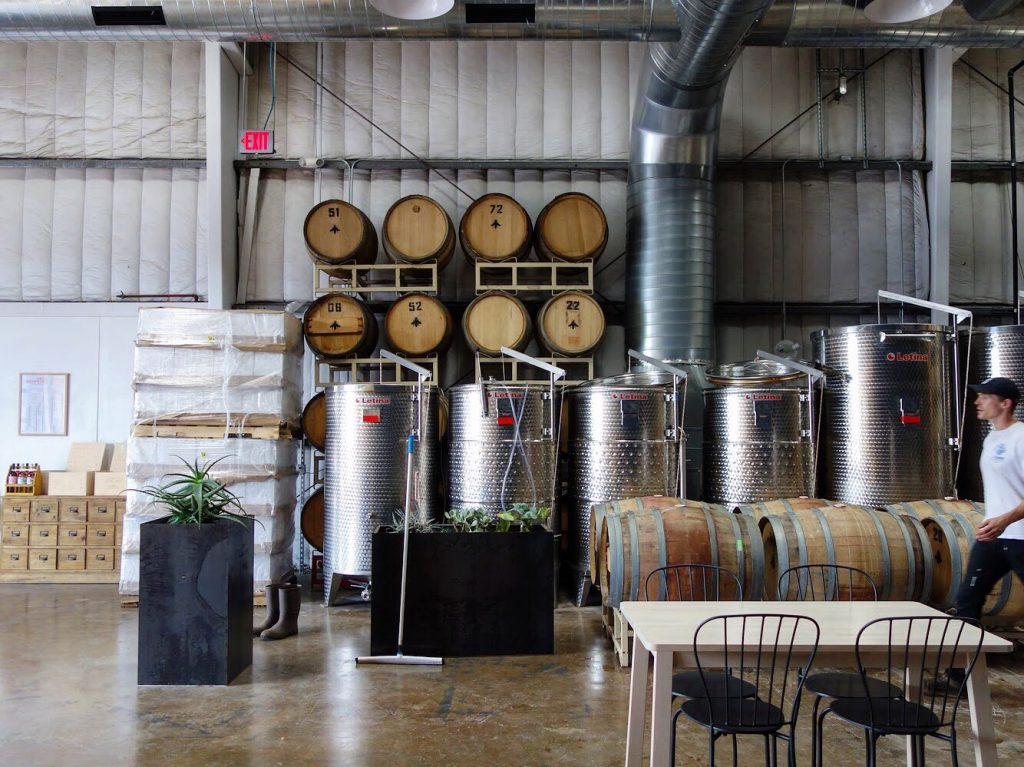 The Austin Winery open warehouse houses the company's office, production facility, and tasting room (Credit:  Susannah Haddad )