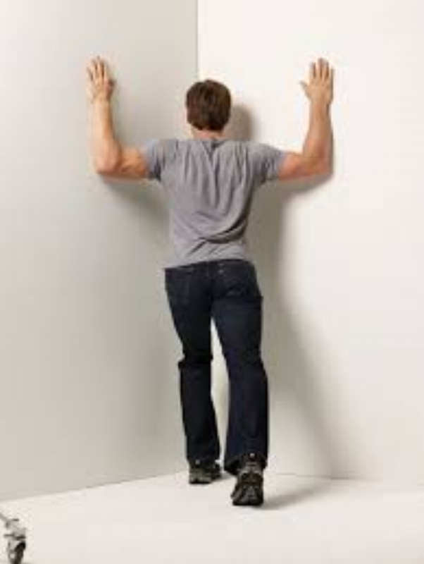 You might have to find a strategic location in your office to perform this stretch. You can always tell your boss you do your best thinking when you are in a corner!