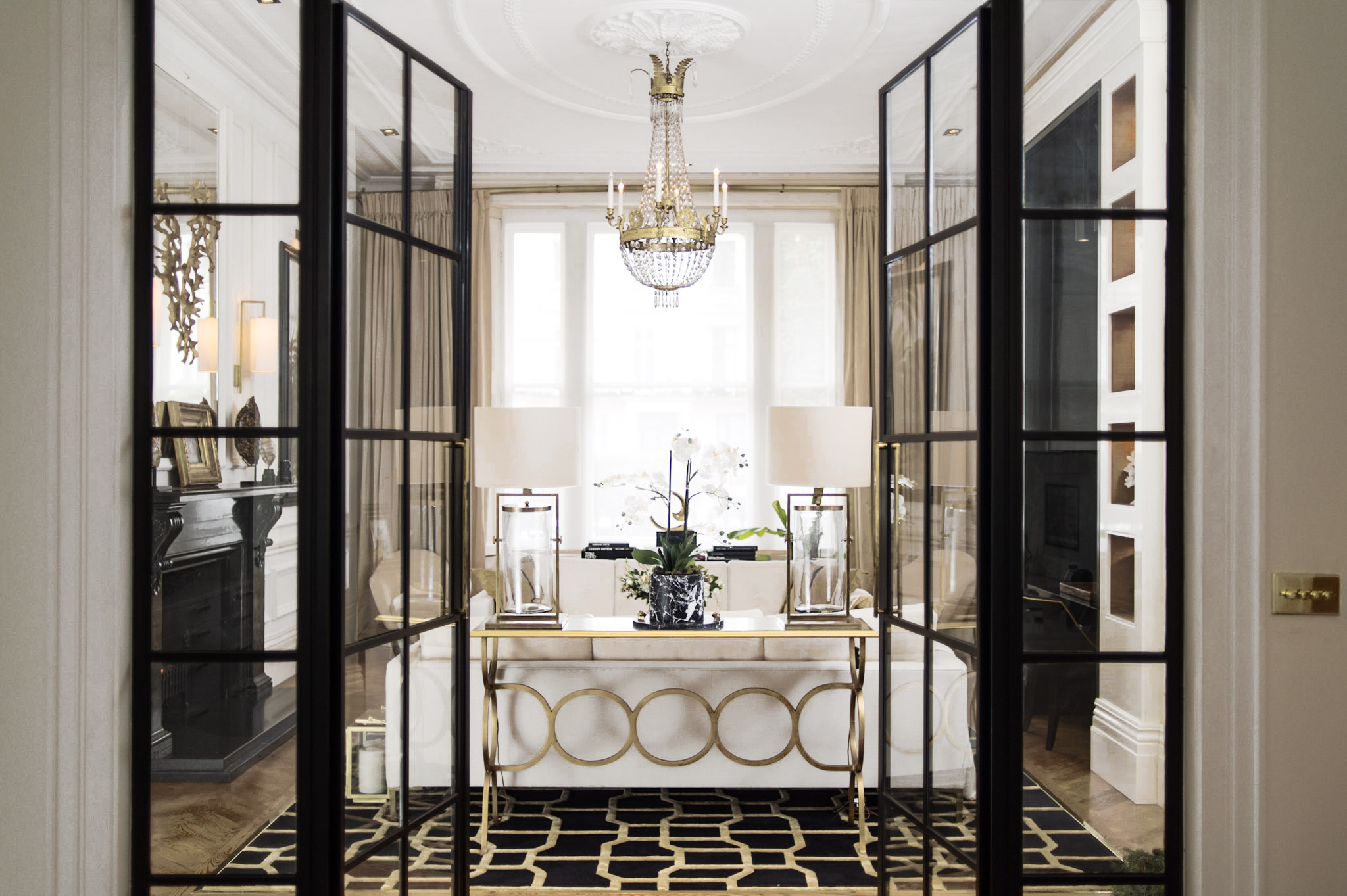 Steel-and-glass doors by  Clement  bring a softly industrial feel to this period setting, while a decorative console from  Jonathan Charles  adds an Art Deco touch. Every sight line was considered. It's a real luxury if every view is a beautiful one.