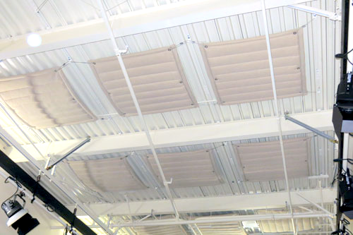 Quilted Baffle Blanket - The Quilted Baffle Blankets work extremely well where localized noise disrupts productivity or comfort in an industrial or public setting. The Quilted Baffle Blanket is generally used in structures with higher ceilings, larger open areas or around operating machinery to capture and stop sound reverberation.The Quilted Baffle Blanket may be hung independently or in groups and can be placed in a staggered formation to create a cloud. Grommets and sewn ends are customized features with standard colors being white and black. Baffle Blanket is Class A Flame Test (ASTM E84) rated.