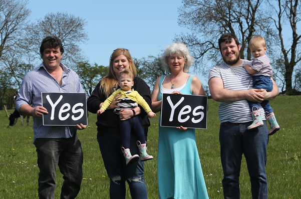 On our Farmers for Yes road trip, this farming family wanted to show their support across 3 generations (photo by Georgina Willis)