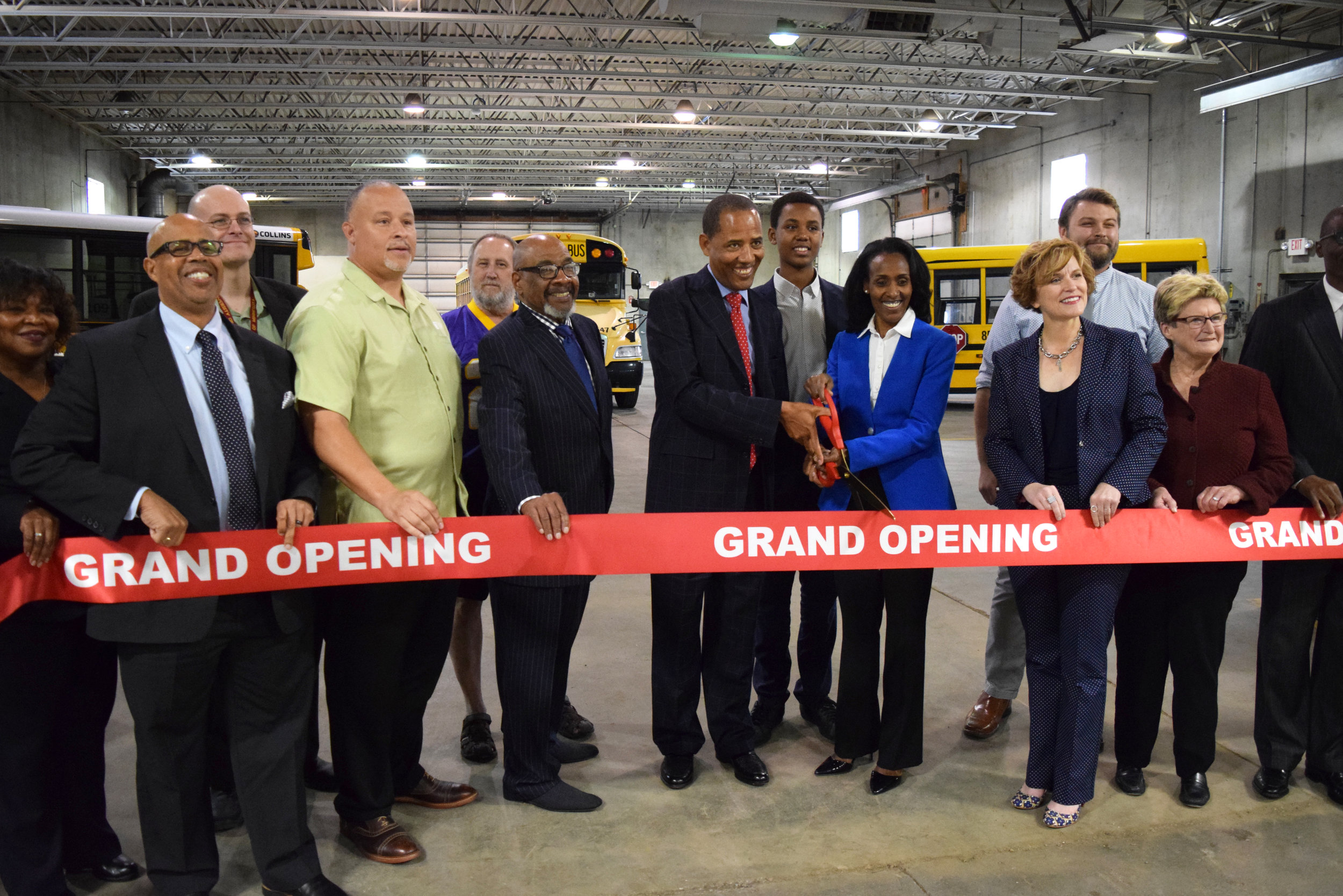 City officials and business leaders gather for a ribbon-cutting ceremony at MTN.    Photo by Cirien Saadeh