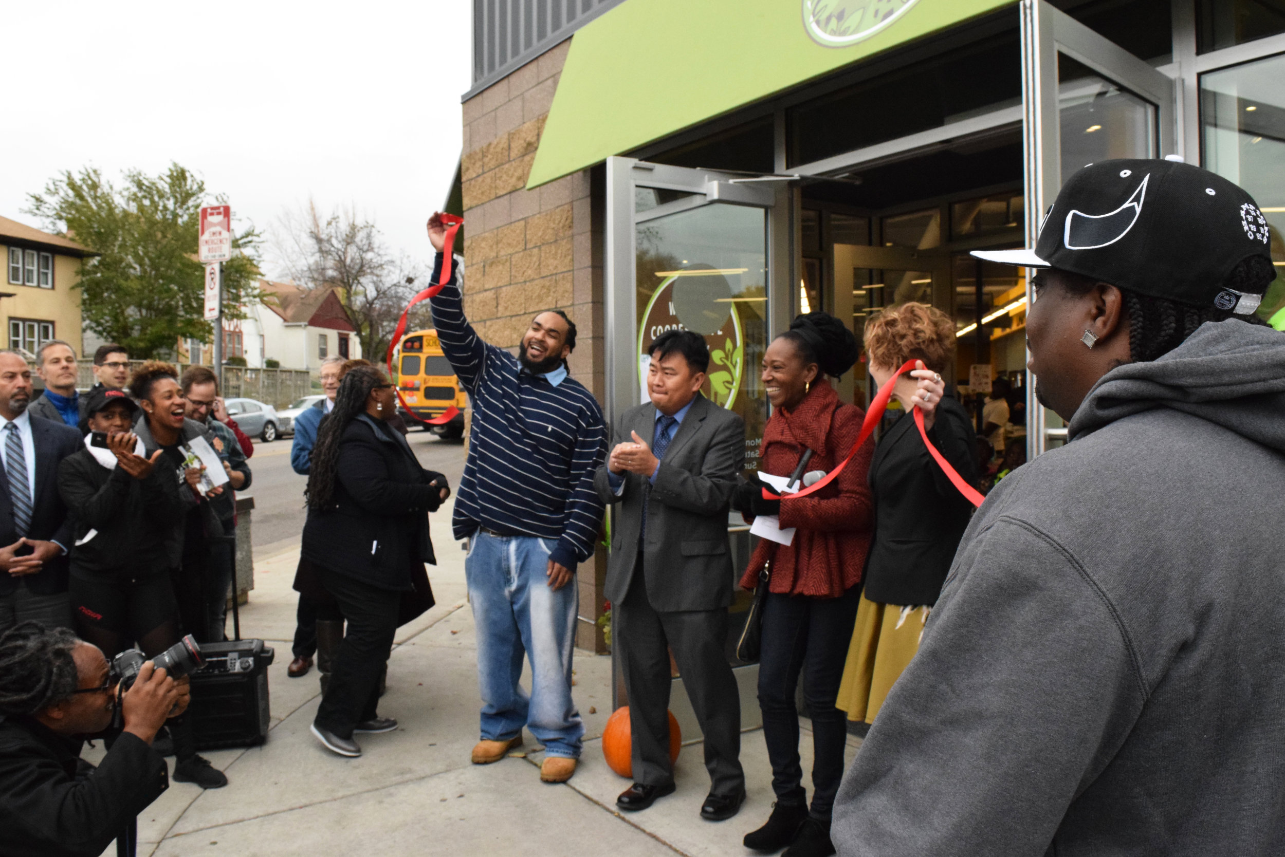 Wirth Co-op general manager Winston Bell (left) celebrated the co-op's grand opening alongside City Council Member Blong Yang, Co-op Board VP Teasha Reid,and Mayor Betsy Hodges.The event was attended by over 50 people. Photo by Cirien Saadeh .