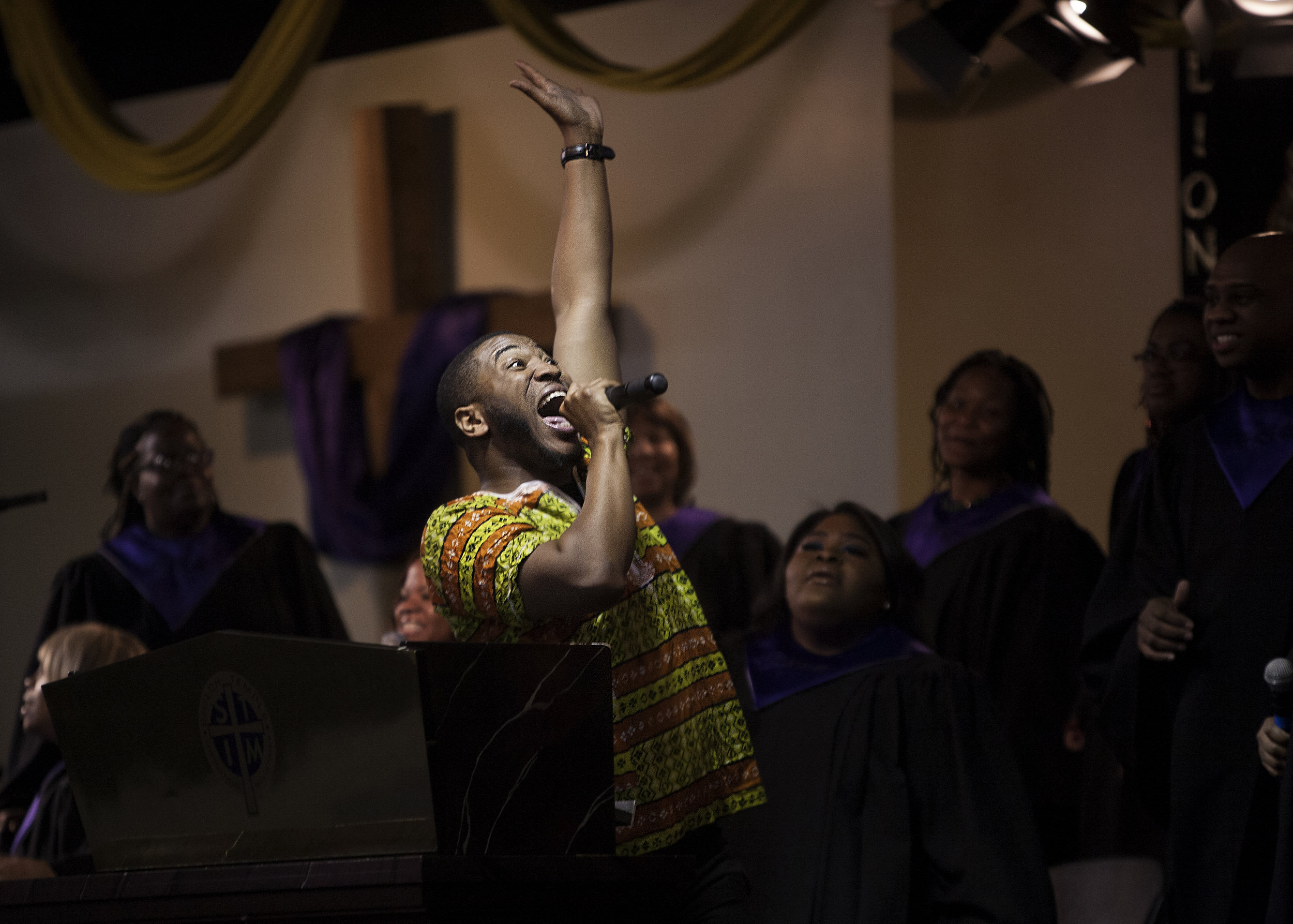 Shiloh Temple choir director Jovonta Patton, a Billboard Chart-topping gospel artist,sings and leads the choir during a Sunday service in February.
