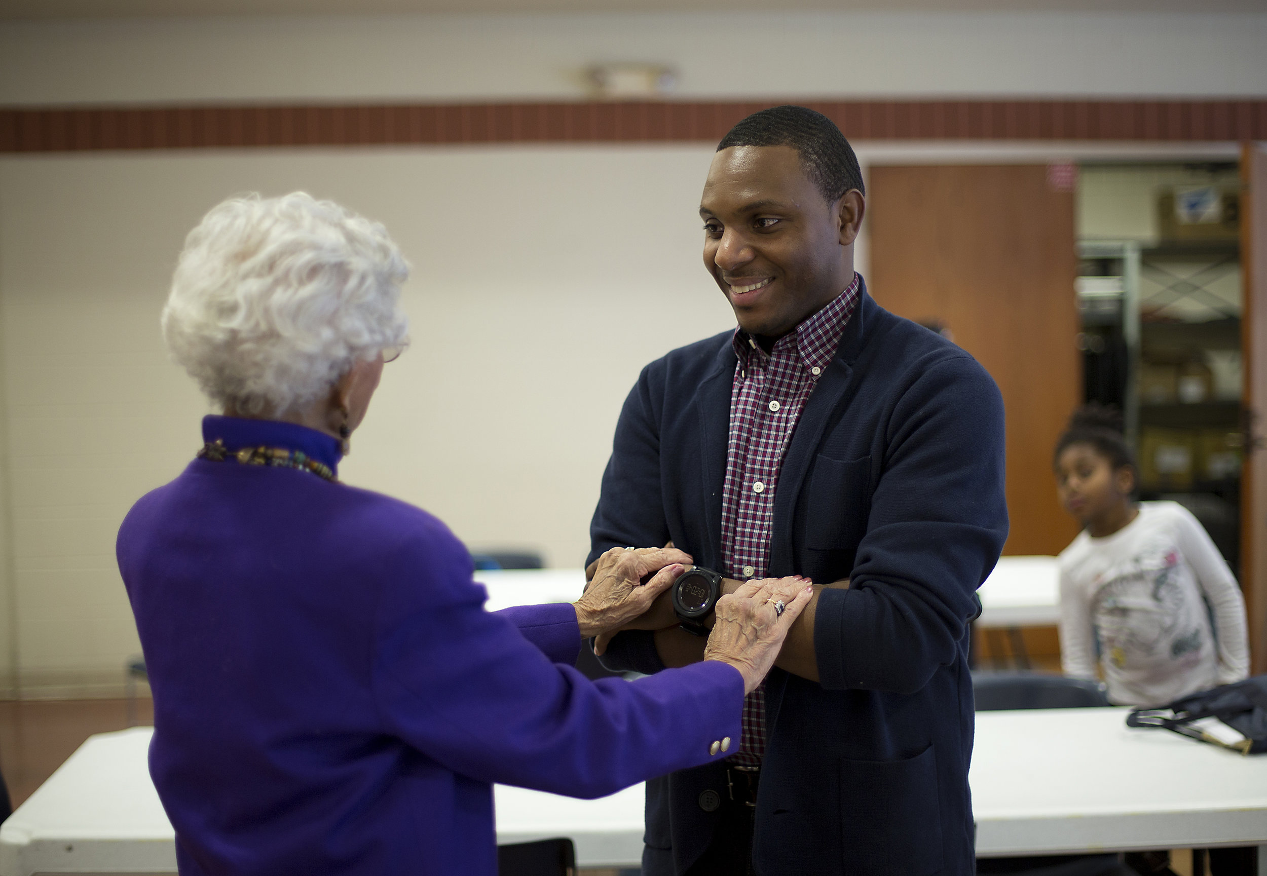 Elizer Darris greets Dr. Josie Johnson before graduating from the African American Leadership Forum's fellowship program in December. The graduation was part of a transformative year for Darris, a motivational speaker, who was recently released from prison.