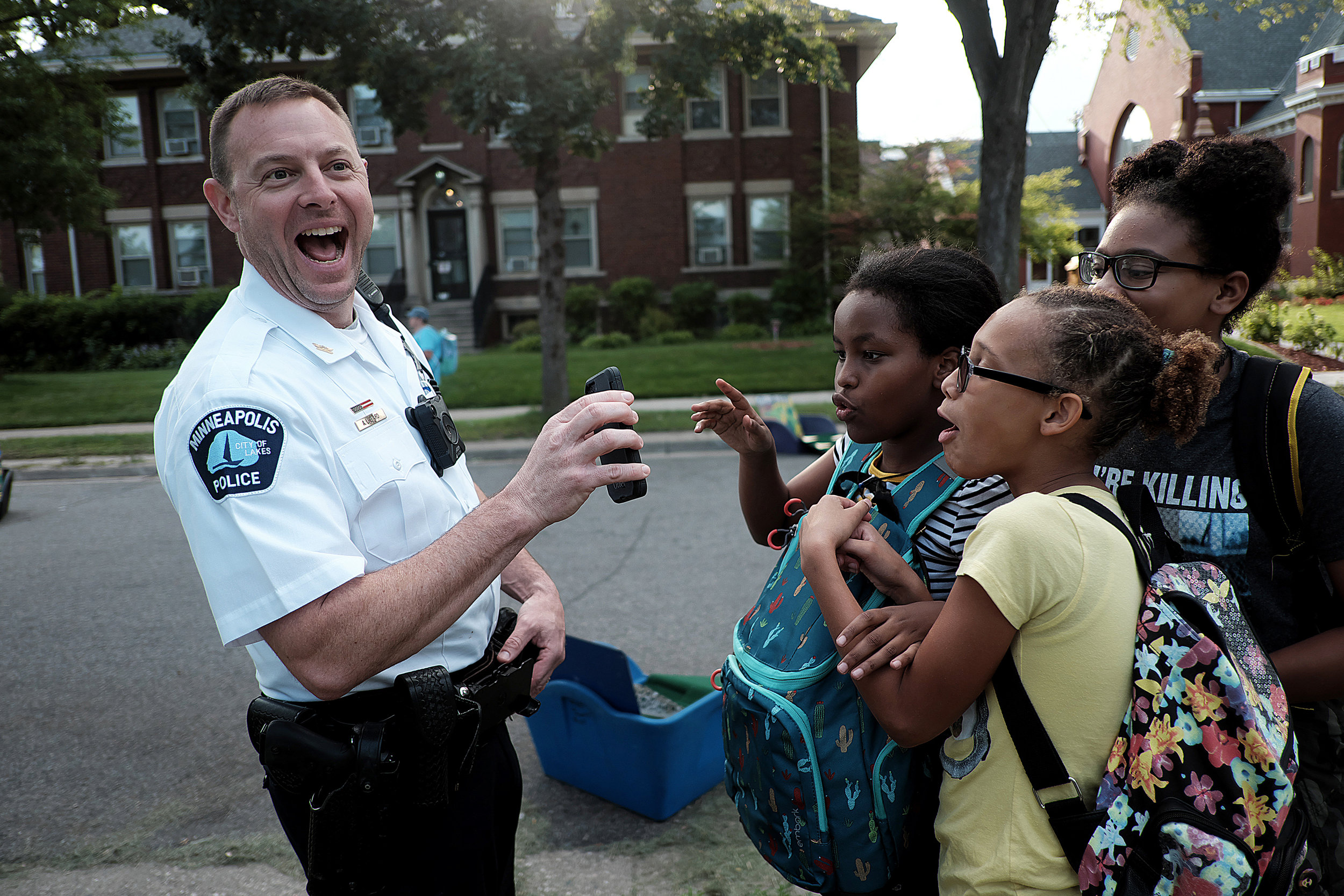 Minneapolis Police Inspector Aaron Biard showed three Ascension Catholic School students a picture he snapped of them with his body camera. Biard was named commander of the Fourth Precinct in June.