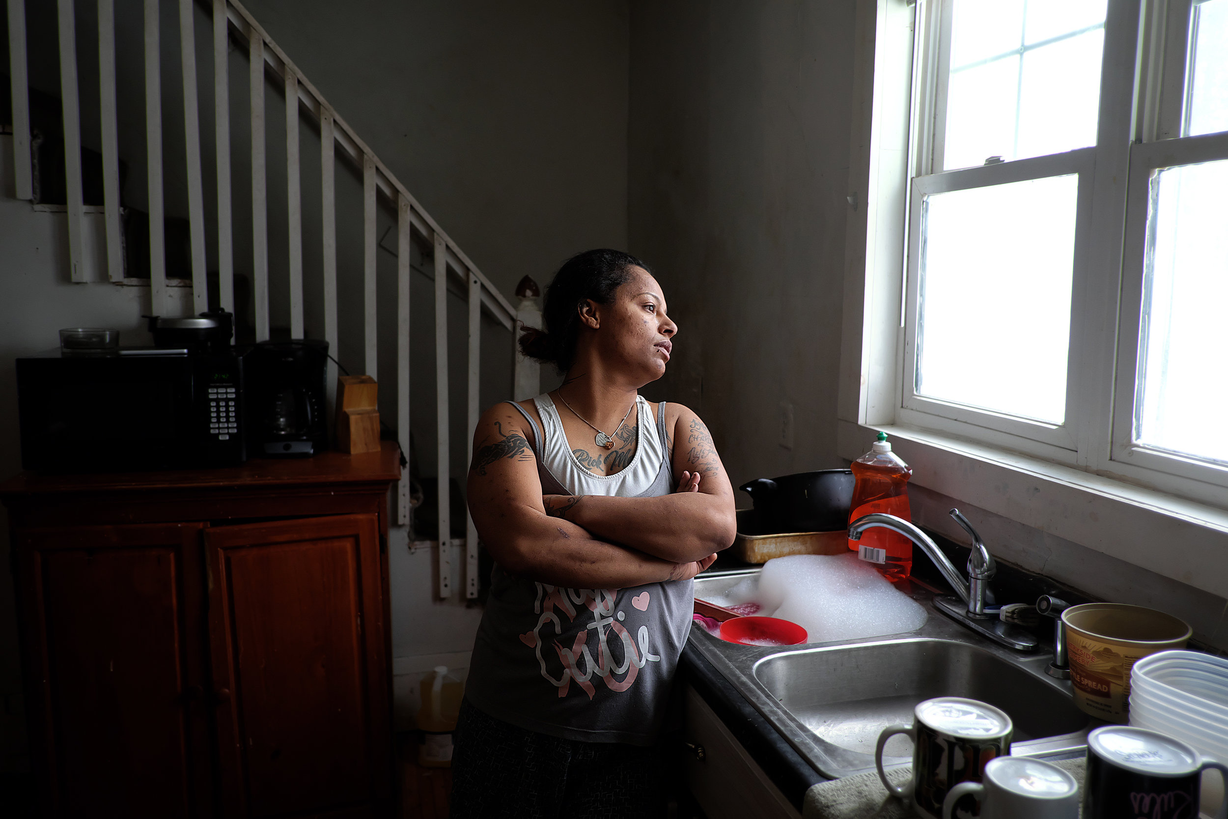 TeCara Ayler is fighting to keep her Penn Ave. home. She has rented it from Mahmood Khan, who lost his rental license in November, for almost three years. Photo by David Pierini