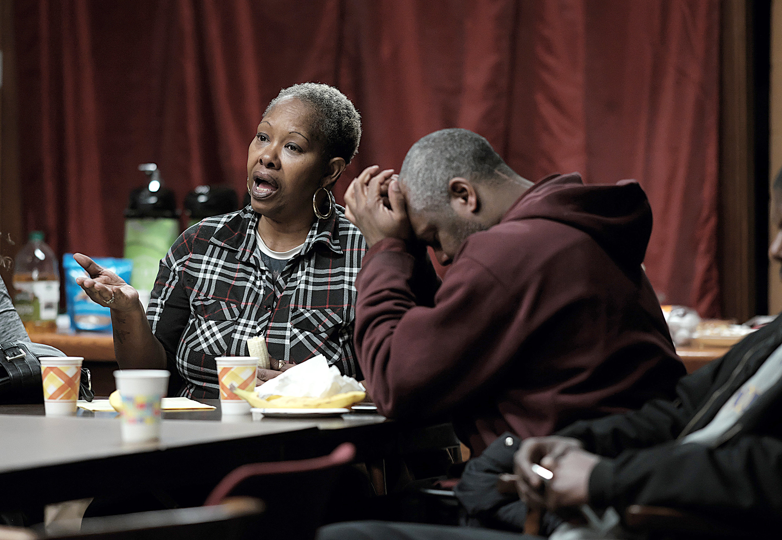 Patricia Gant and her husband, Maurice, shared their experiences living in a Khan property and fear of an uncertain housing situation during a resource meeting for Khan tenants at St. Olaf Church in January.  Photo by David Pierini