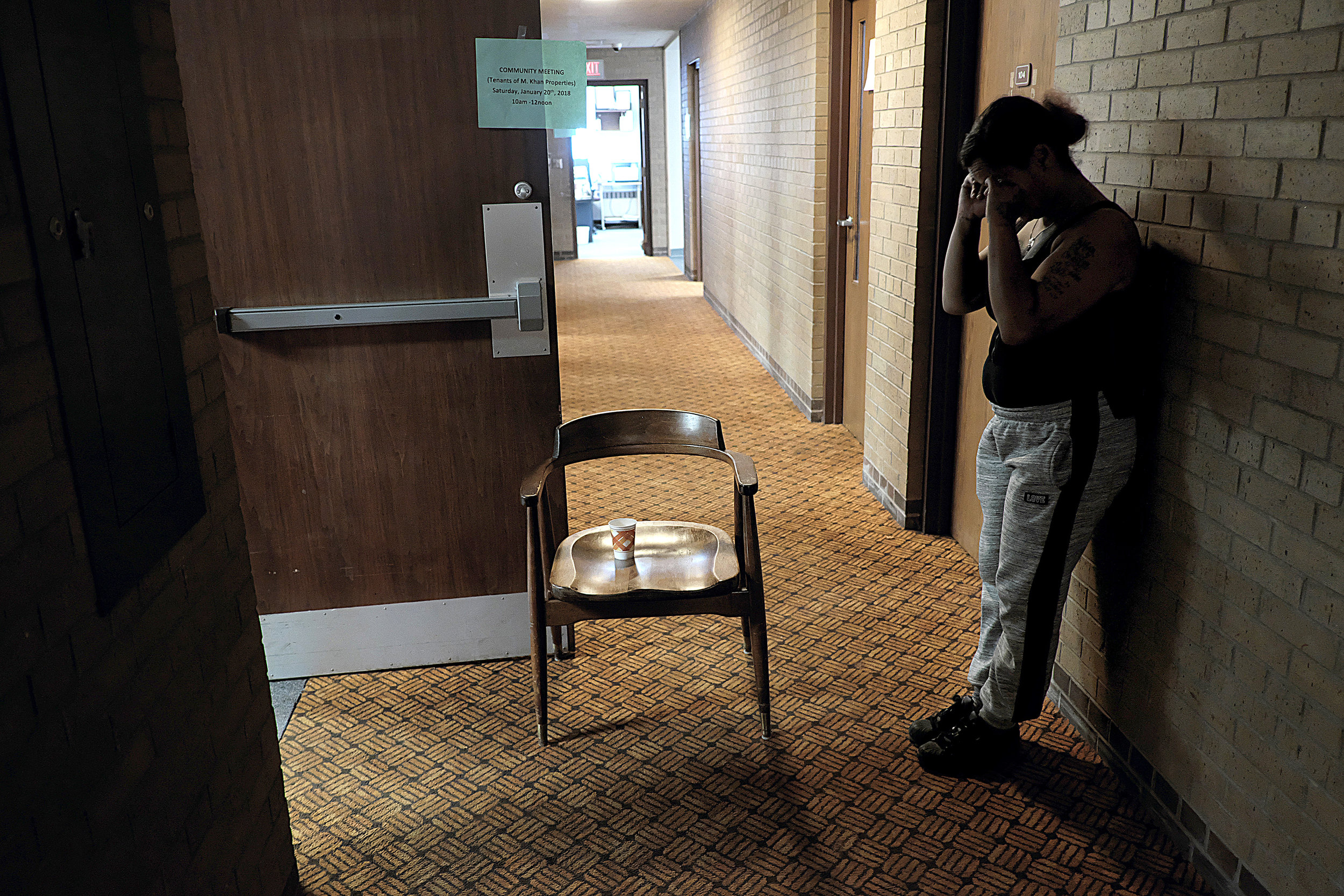 """TeCara Ayler takes a quiet moment to collect herself after becoming overwhelmed with emotion at a resource meeting for Khan tenants in mid-January. """"Day to day it's stressful. You don't know what's going to happen,"""" she said.  Photo by David Pierini"""