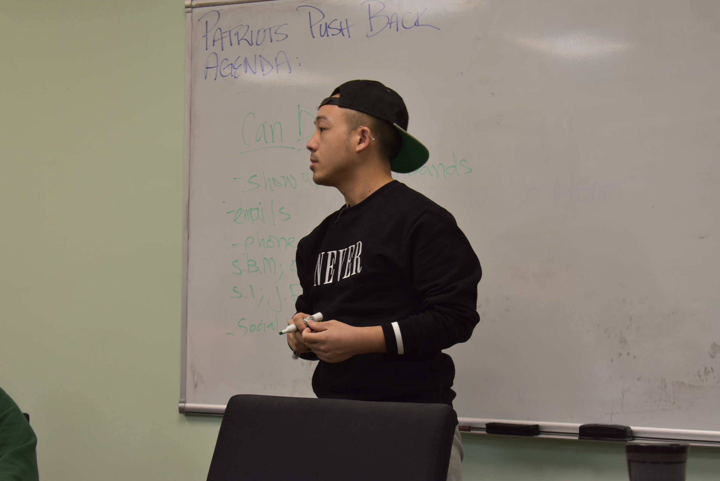 Chong Vang, a Patrick Henry High School (PHHS) graduate, co-facilitated a March 17 meeting among community members to discuss the potential impact of $1.9 million in budget cuts at his alma mater.The meeting was held at the Minneapolis Federation of Teachers building (67 8th Ave. NE). About 25 students, parents, and alumni came out to support teachers and express their frustration over the proposed budget cuts. Photo by Cirien Saadeh