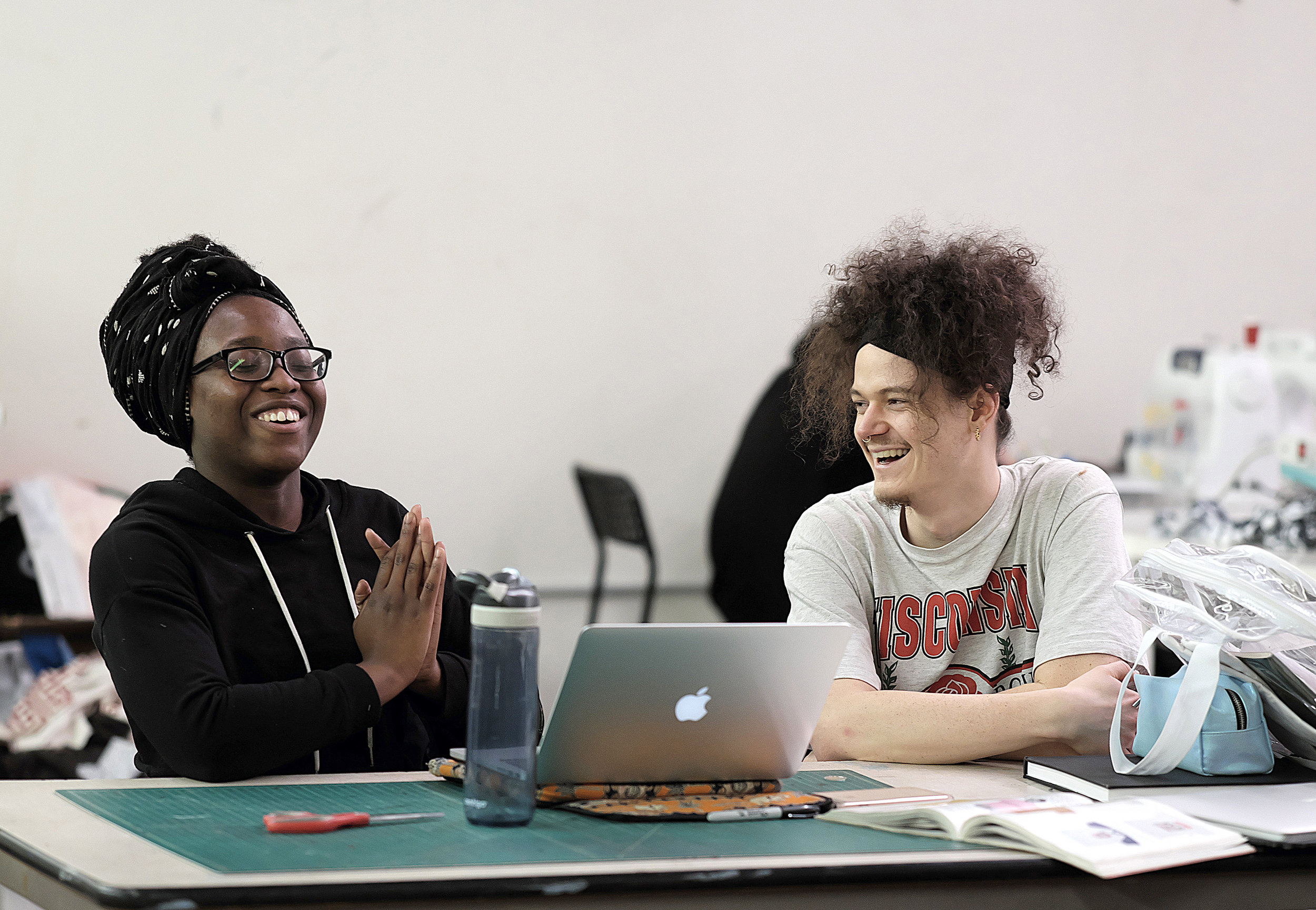 Ashley Koudou (left), an MCAD senior, leads a branding and identity workshop for JXTA youth apprentices with Textiles and Screen Printing Lab lead, Saulaman Schlegel.  Photo by David Pierini