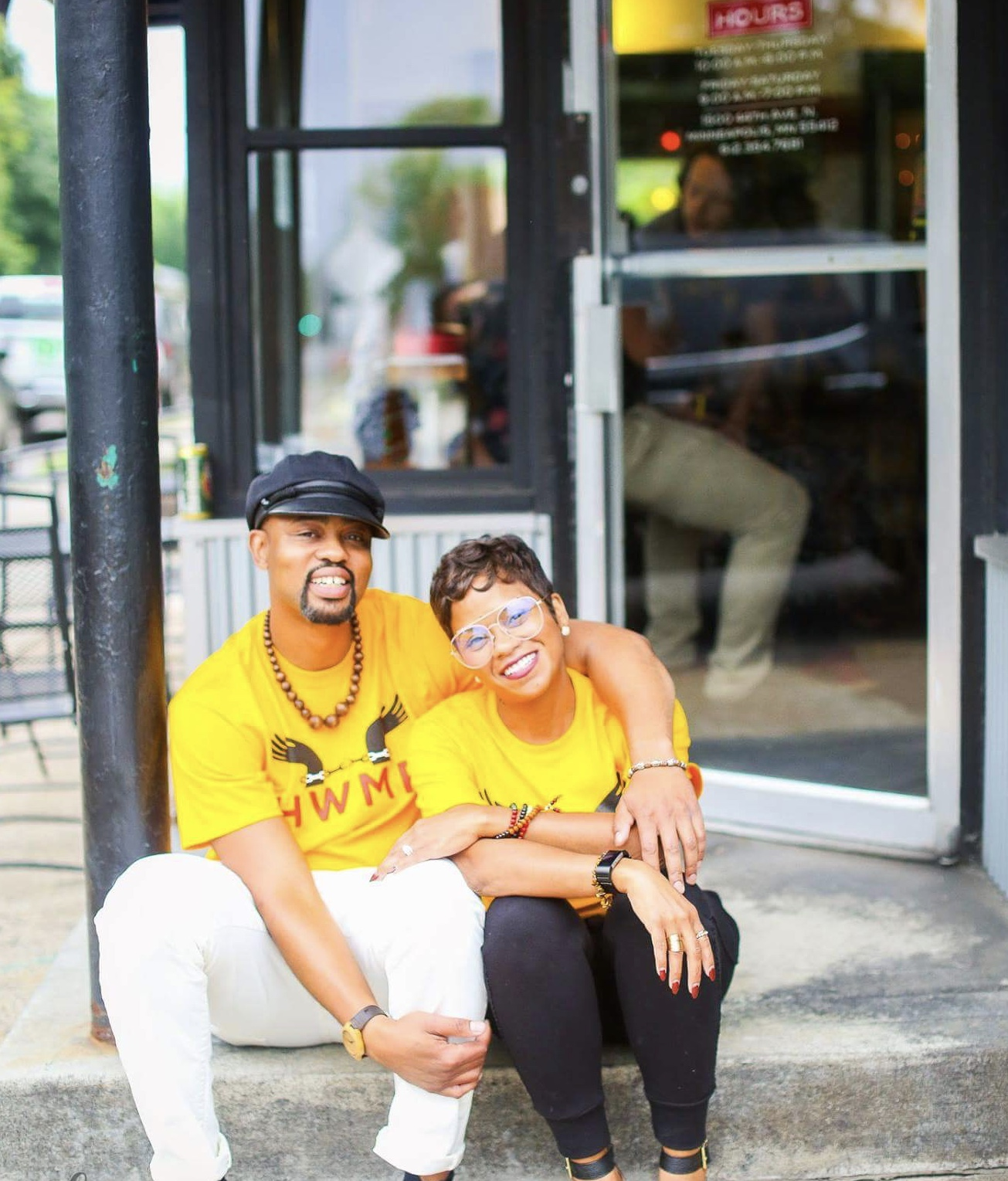 White and his wife Donise sit outside HWMR in warmer months. Donise inspired the women's clothing line at the shop.  Photo by Katherine Harris