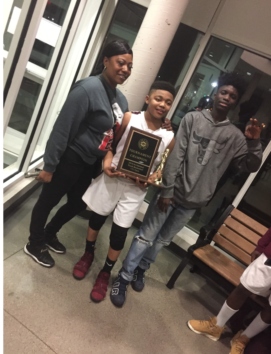 This me and my brother, Andre Frazier, and mom, Ashley Burns, at my little brother's game after he won a championship on May 1. I love my family, and we were so happy after my brother's win. He looks up to me, so him seeing me playing sports and stuff is what make him do the same. He sees me not being in the streets or hanging with the wrong crowd, and he does the same thing. My mom motivates both of us to the fullest in every sport that we play. She is at every one of our games; she makes sure that we eat healthy food, and she makes sure we stay in shape. She also comes to our practices. She makes sure our grades are ok. She tells us that if our grades aren't where she wants them to be that we don't be playing. She'll take basketball away from us if our grades aren't good or if we're doing something else we're not supposed to.