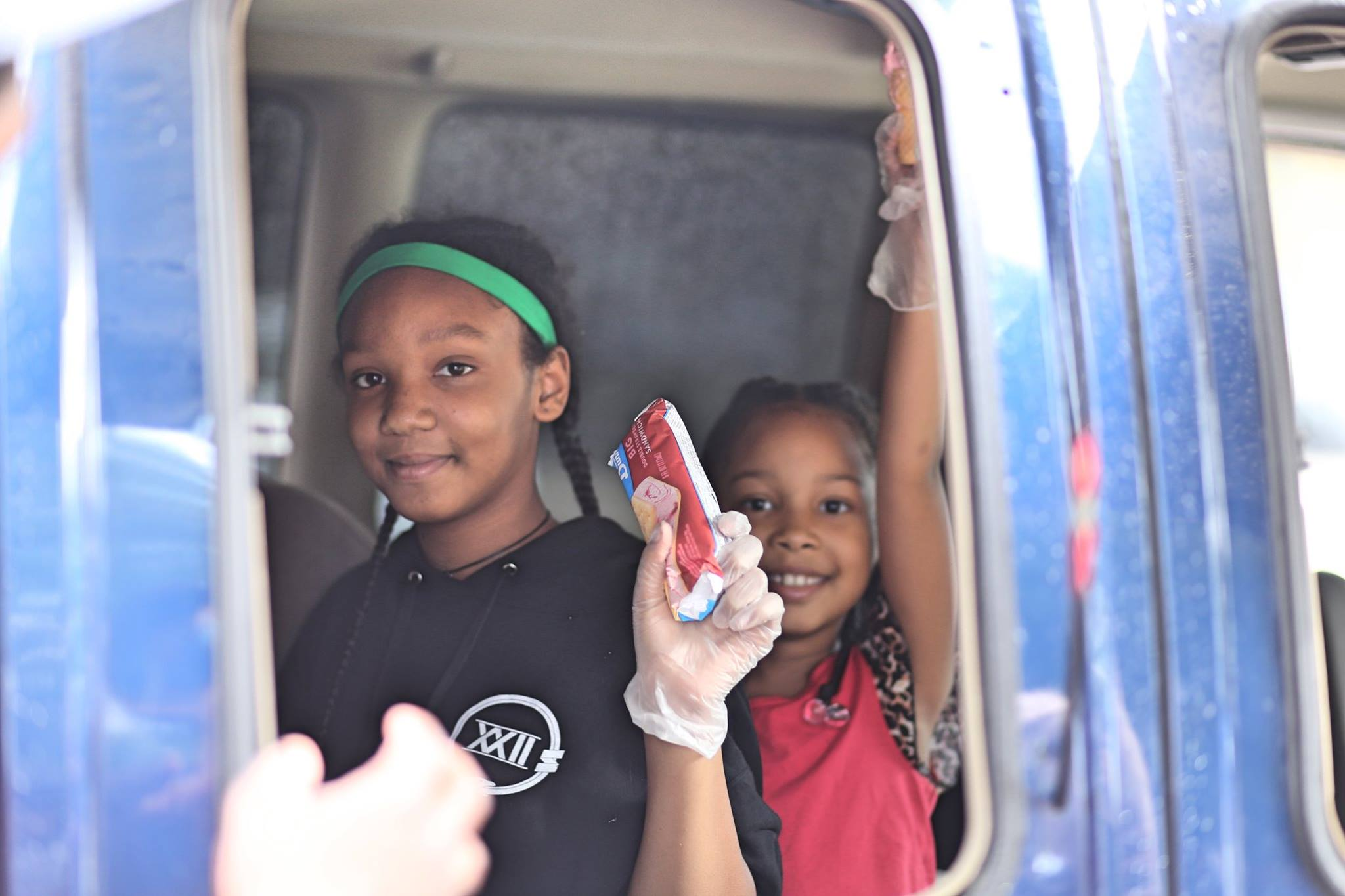 Isis and Oya Bridewell have been selling ice cream out of an old fashioned truck driven by their dad this summer. During Thursday night FLOW, they parked on Plymouth Ave.  Photo by Azhae'la Hanson