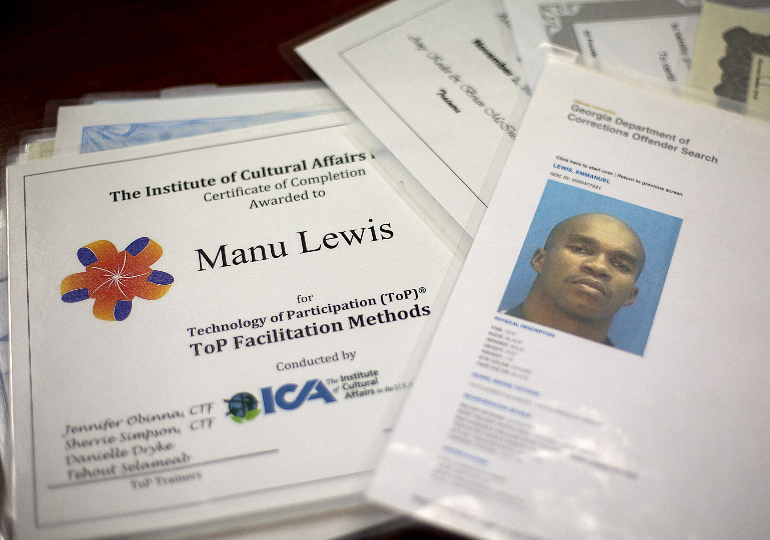 Lewis shows his clients evidence of his past mistakes (his criminal record) and his efforts to continue his education through certificates and trainings.