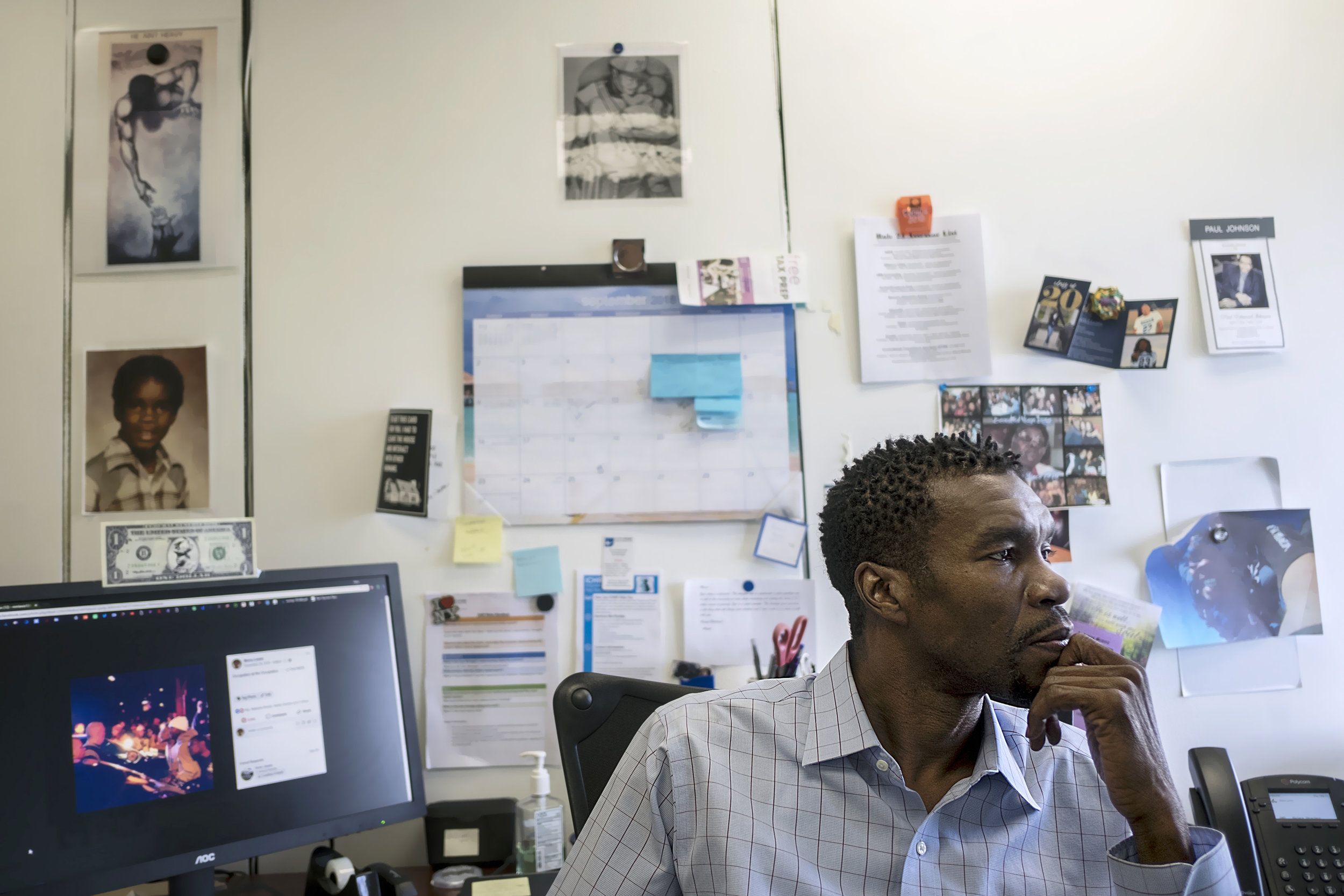 Manu Lewis sits in his office at NorthPoint Health and Wellness Center. He has worked there for three years.