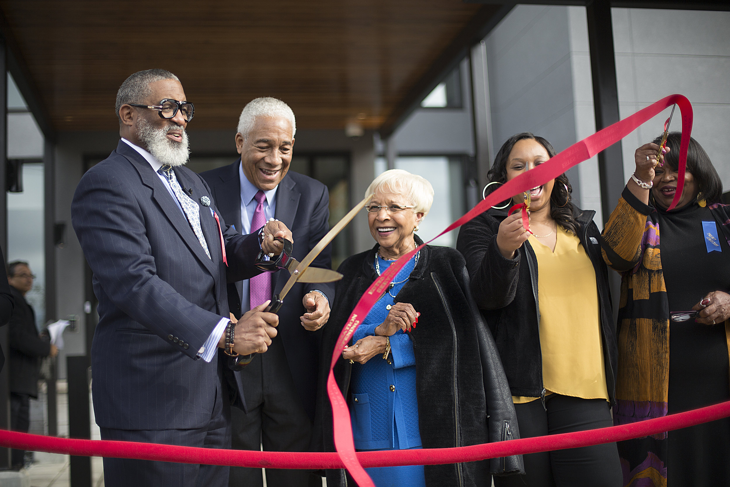 From left, Estes CEO Tracy Wesley, project consultant Bob Ryan, and Estes owner April Estes ceremoniously cut a ribbon at Estes' Opening Celebration on Oct. 14.