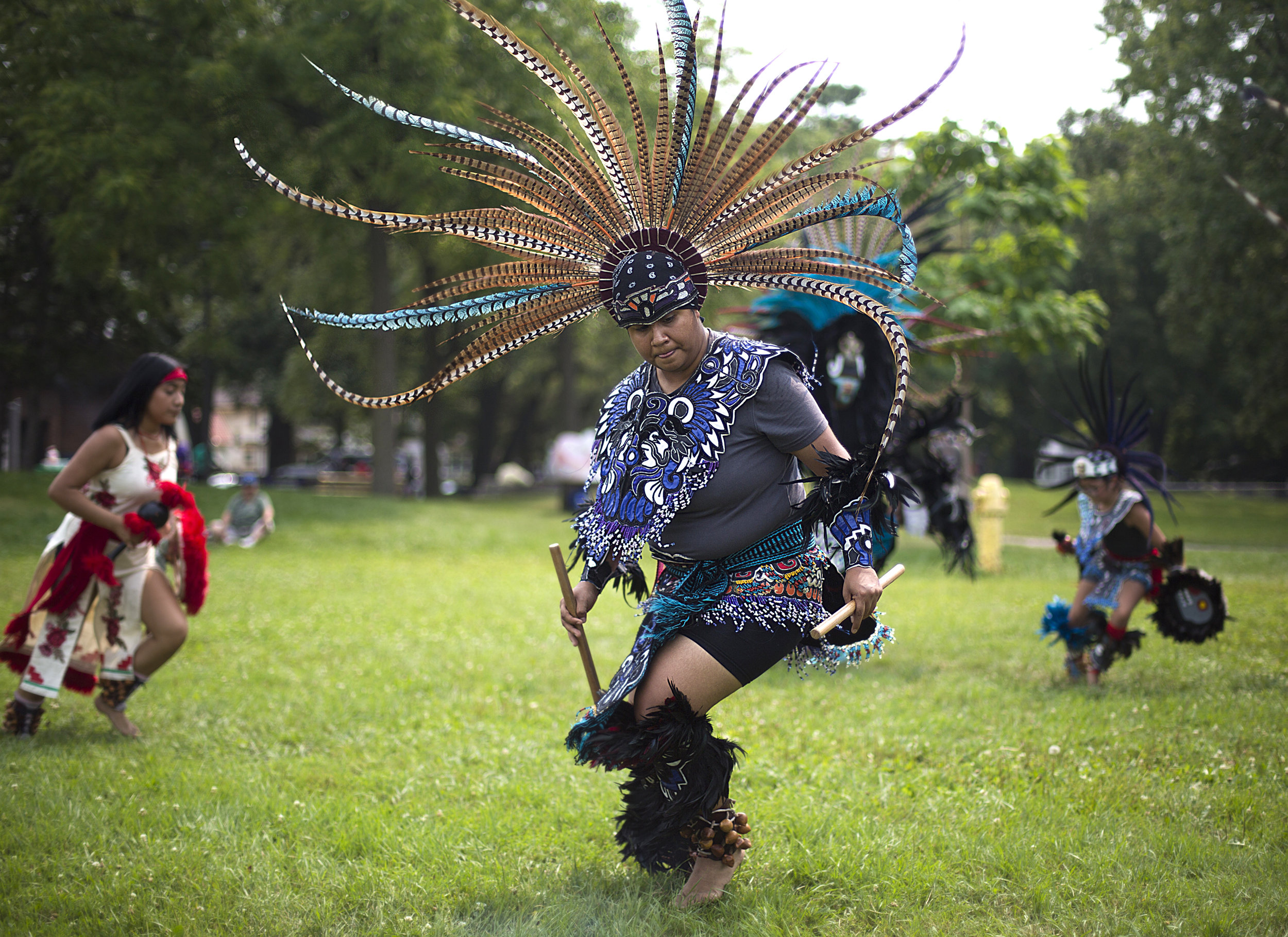 The Aztec dance troupe Kalpulli Ketzal Coatlicue, including Rolis Marin, center, performed Aug. 11 at the Annual Festival of Fathers and Family at North Commons Park.