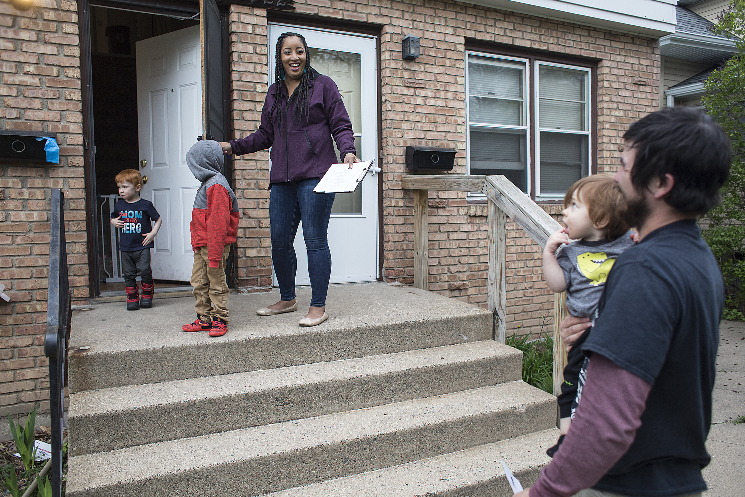 """McKinley Community's new executive director Markella Smith has spent her spring evenings doorknocking in the neighborhood with her young sons. She says her goals are to """"Show my kids something different and make some changes on the Northside that positively impact the people that are here."""" Photo by David Pierini"""