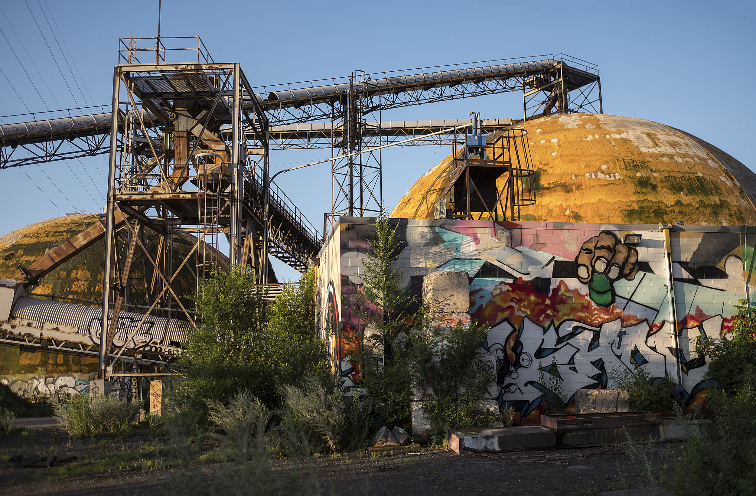 Along the Mississippi River in North Minneapolis, a former barge shipping terminal sits covered in graffiti and weeds.  Photo by David Pierini