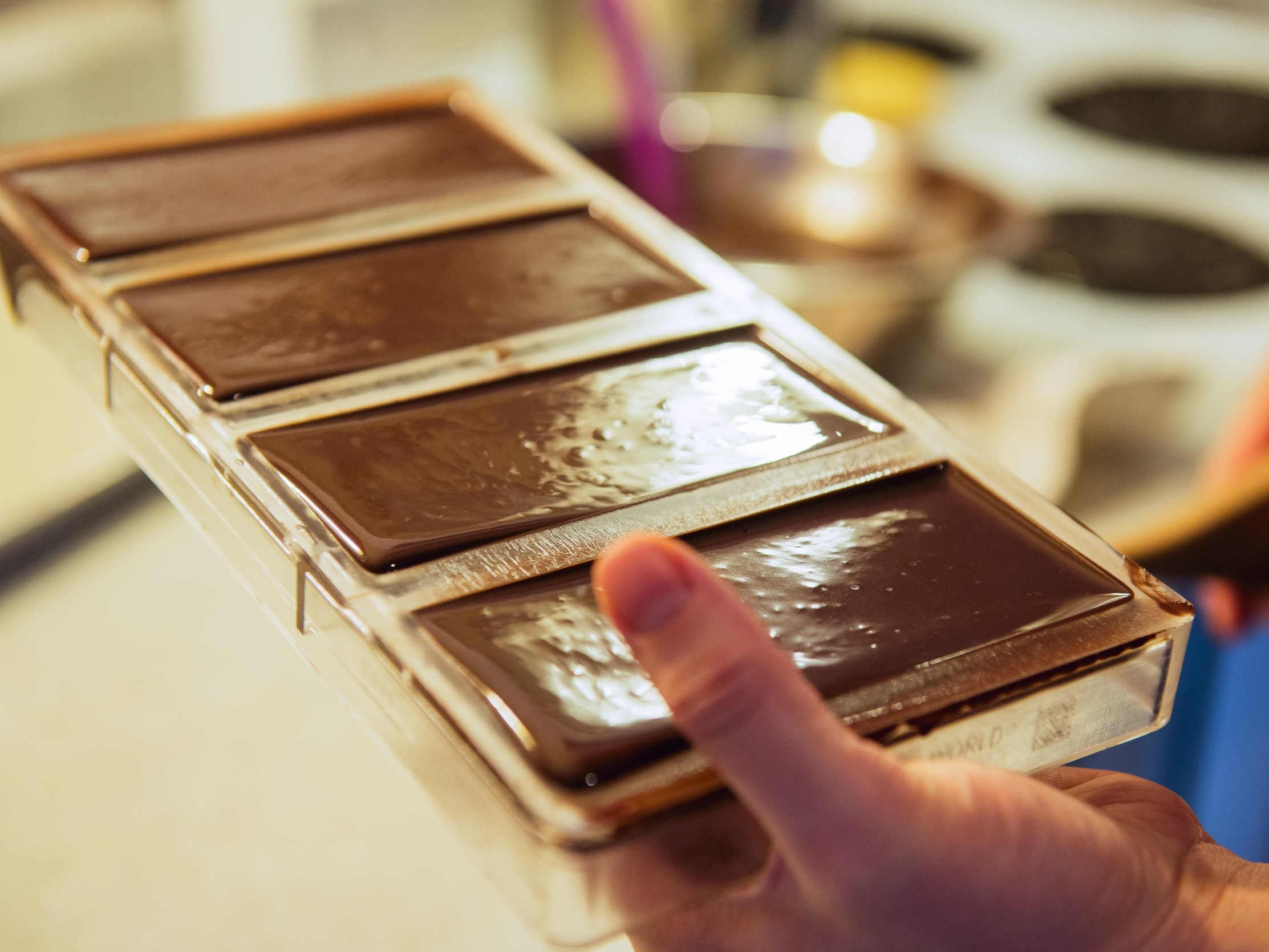 Moulding - Finally, the chocolate is ready to be moulded into a bar, packaged, and enjoyed by you.