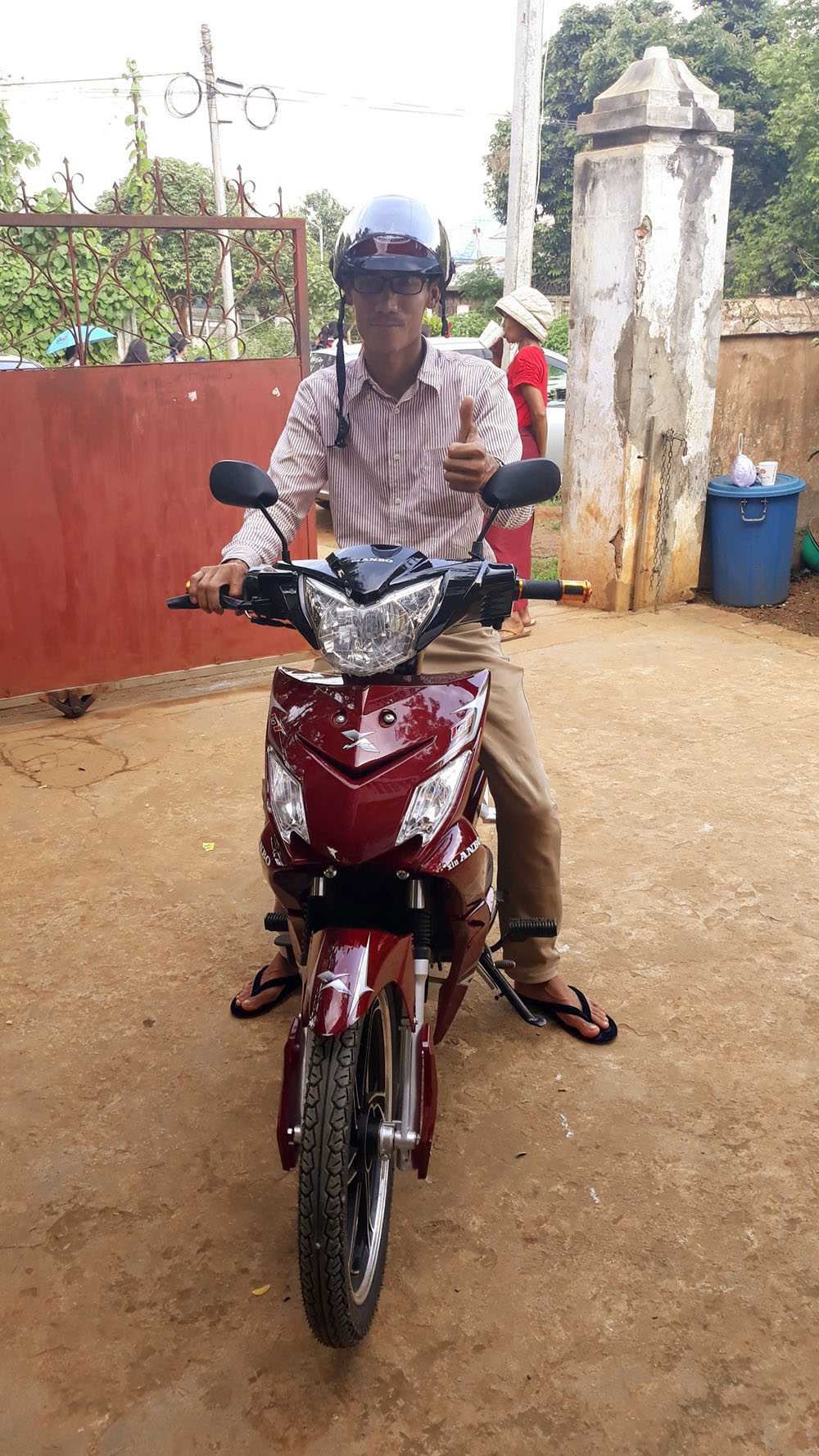 Aung and his motorbike
