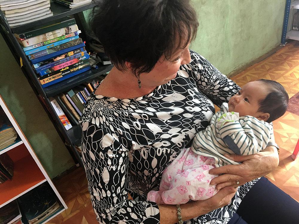 Holding precious little Rachel (her Burmese name means Snow Emerald)