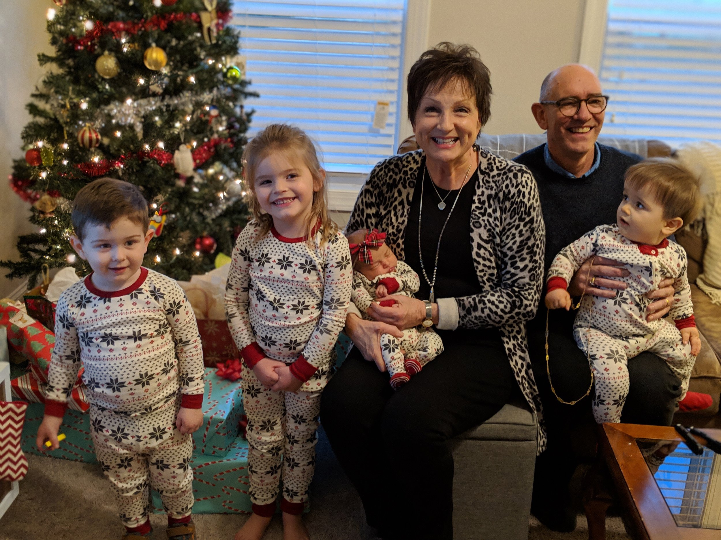 Jim & Nancy with their four grandchildren (left to right: Henry, Eve, Lucy and Jack)