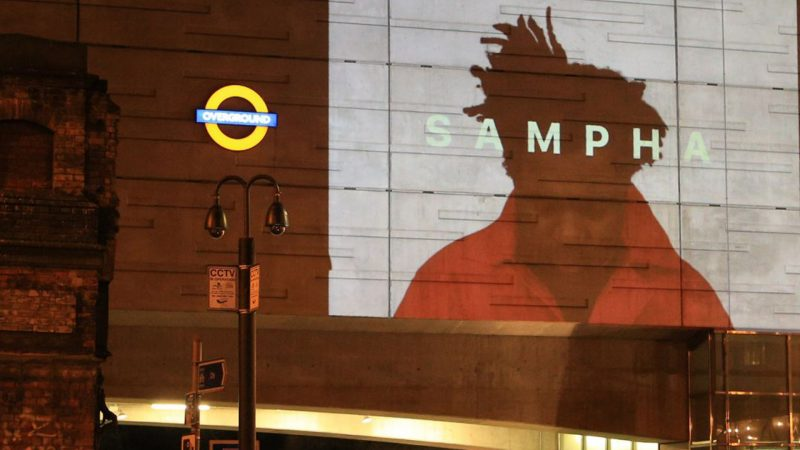 Sampha's video projected in Shoreditch High Street Station in a guerilla film intervention in London.