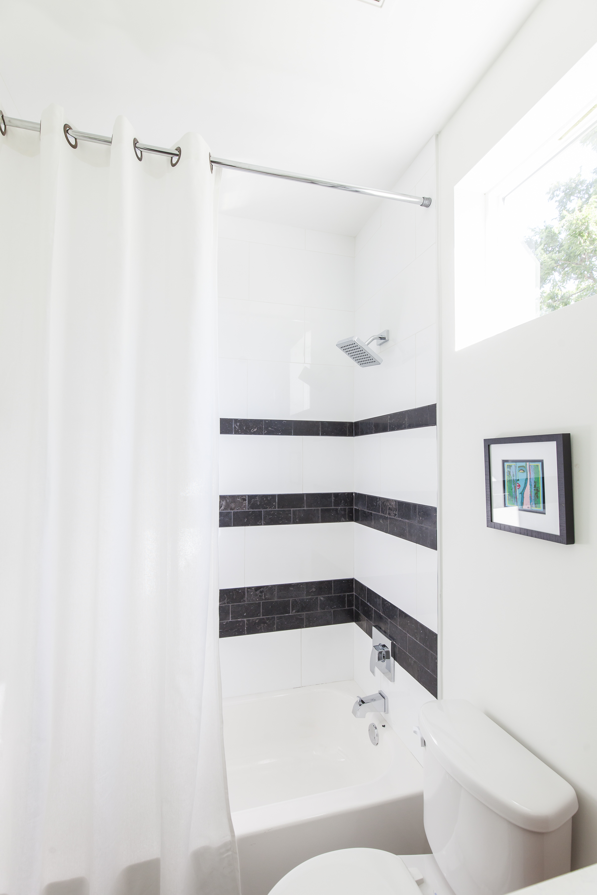 Light and Bright guest bath  featured in Austin Home