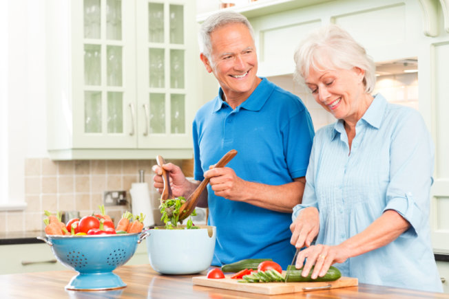Older couple preparing vegetables in kitchen (Source:  usnews )