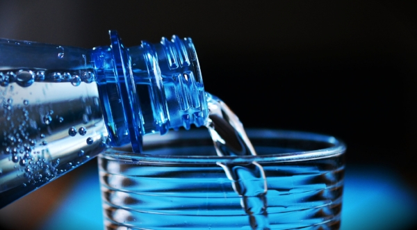 pouring water into glass blue-bottle-close-up-327090.jpg