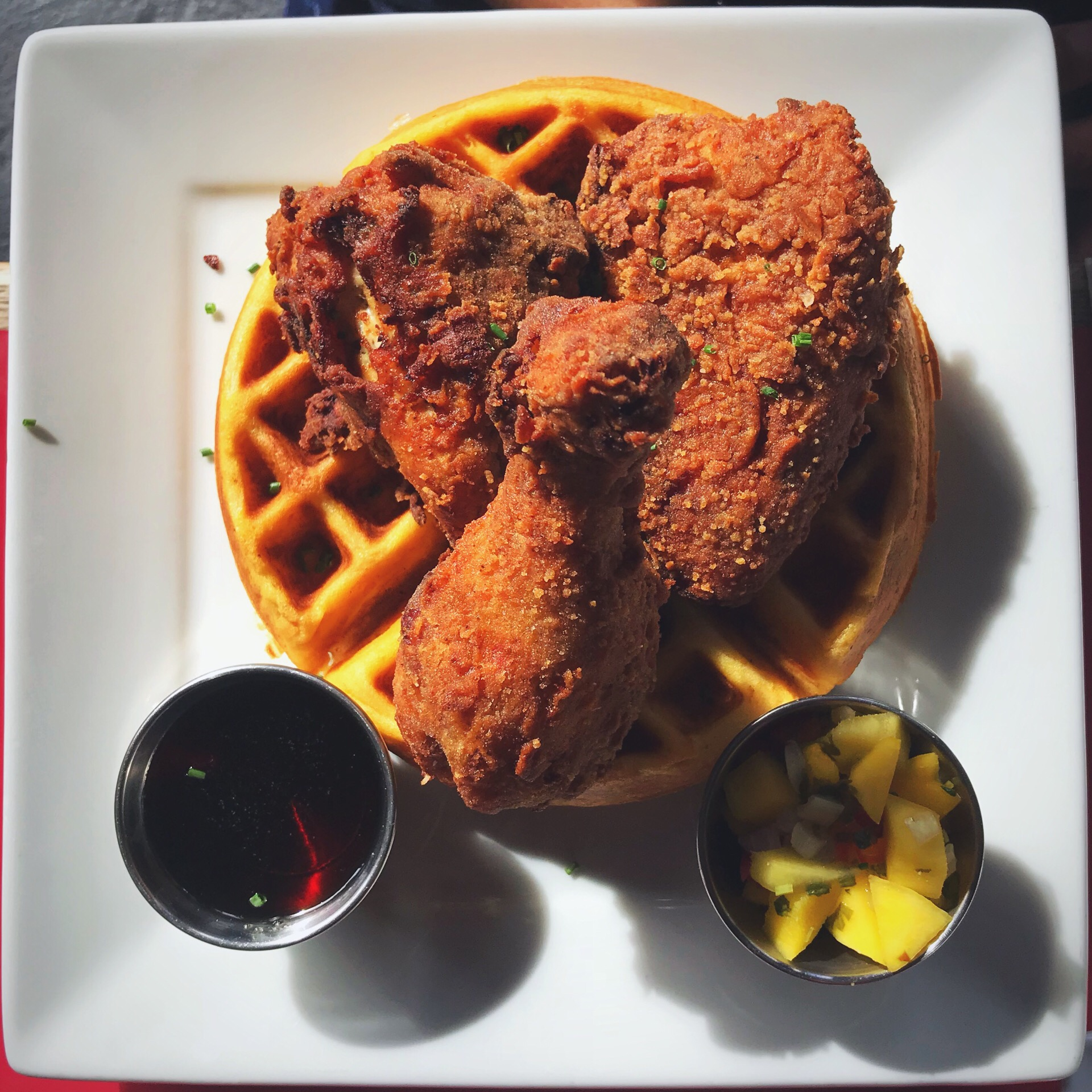 Fried Chicken & Sweet Potato Waffle with Mango Salsa & Syrup. - Photo Credit: Mechelle Miller